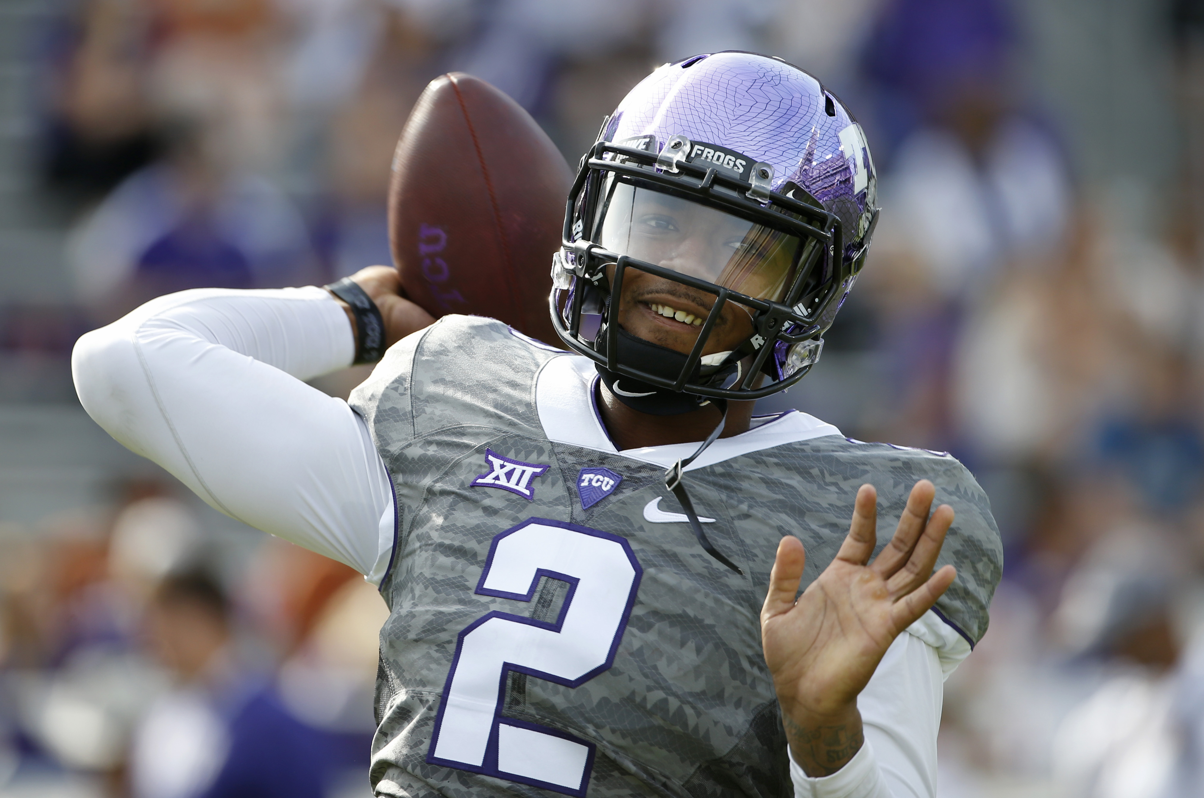 CORRECTS DATE TO OCT. 3, NOT OCT. 2 - TCU quarterback Trevone Boykin (2) throws before the TCU Horned Frogs take on the Texas Longhorns in a NCAA football game Saturday, Oct. 3, 2015, in Fort Worth, Texas. (AP Photo/Ron Jenkins)