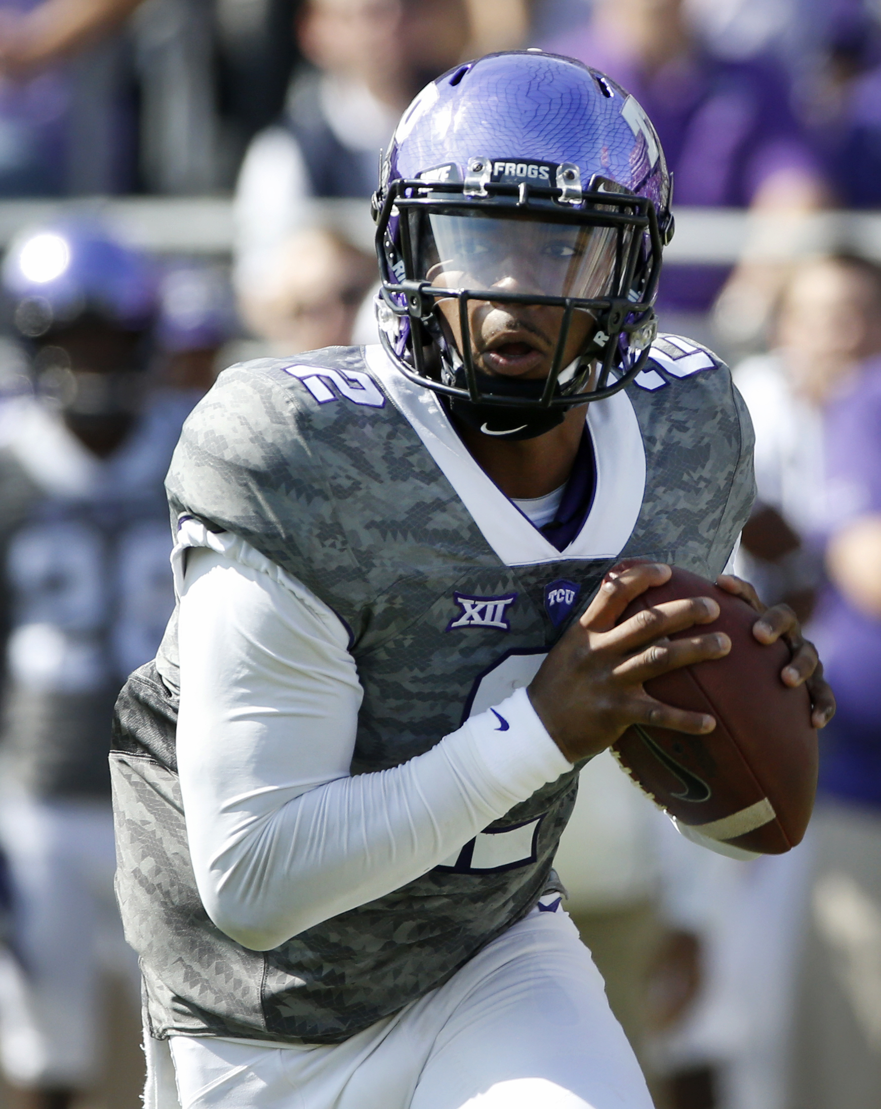 TCU quarterback Trevone Boykin (2) looks to throw in the first quarter of an NCAA college football game against Texas, Saturday, Oct. 3, 2015, in Fort Worth, Texas. (AP Photo/Ron Jenkins)