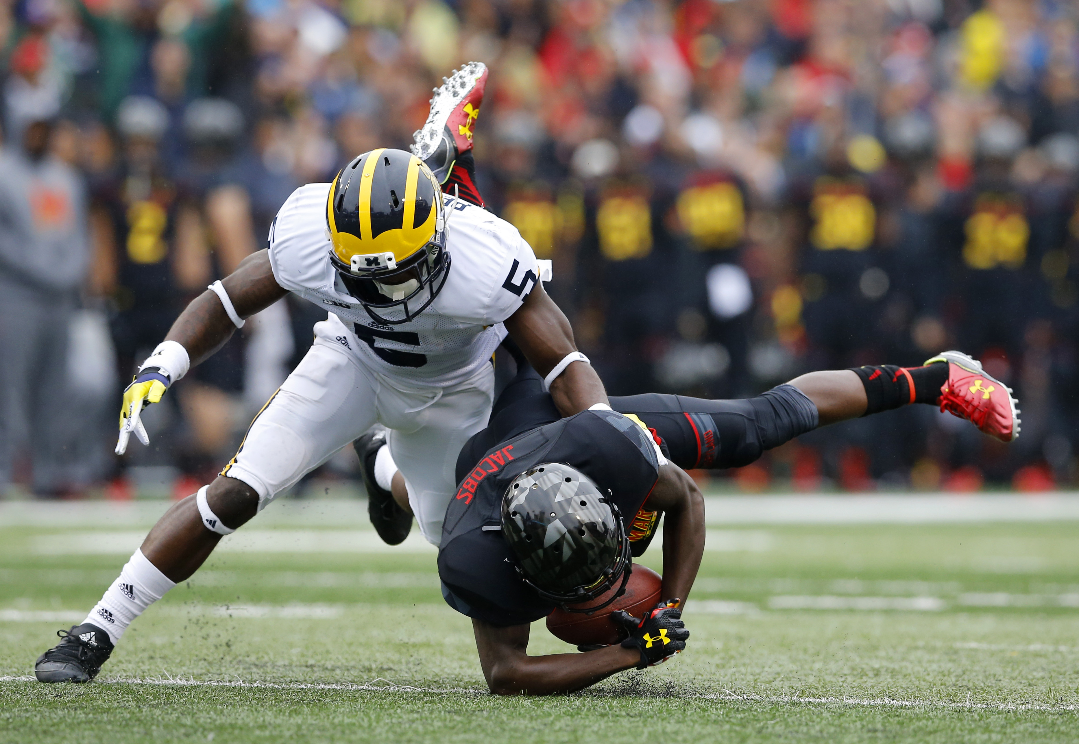 Michigan safety Jabrill Peppers, left, tackles Maryland wide receiver Levern Jacobs in the first half of an NCAA college football game, Saturday, Oct. 3, 2015, in College Park, Md. (AP Photo/Patrick Semansky)
