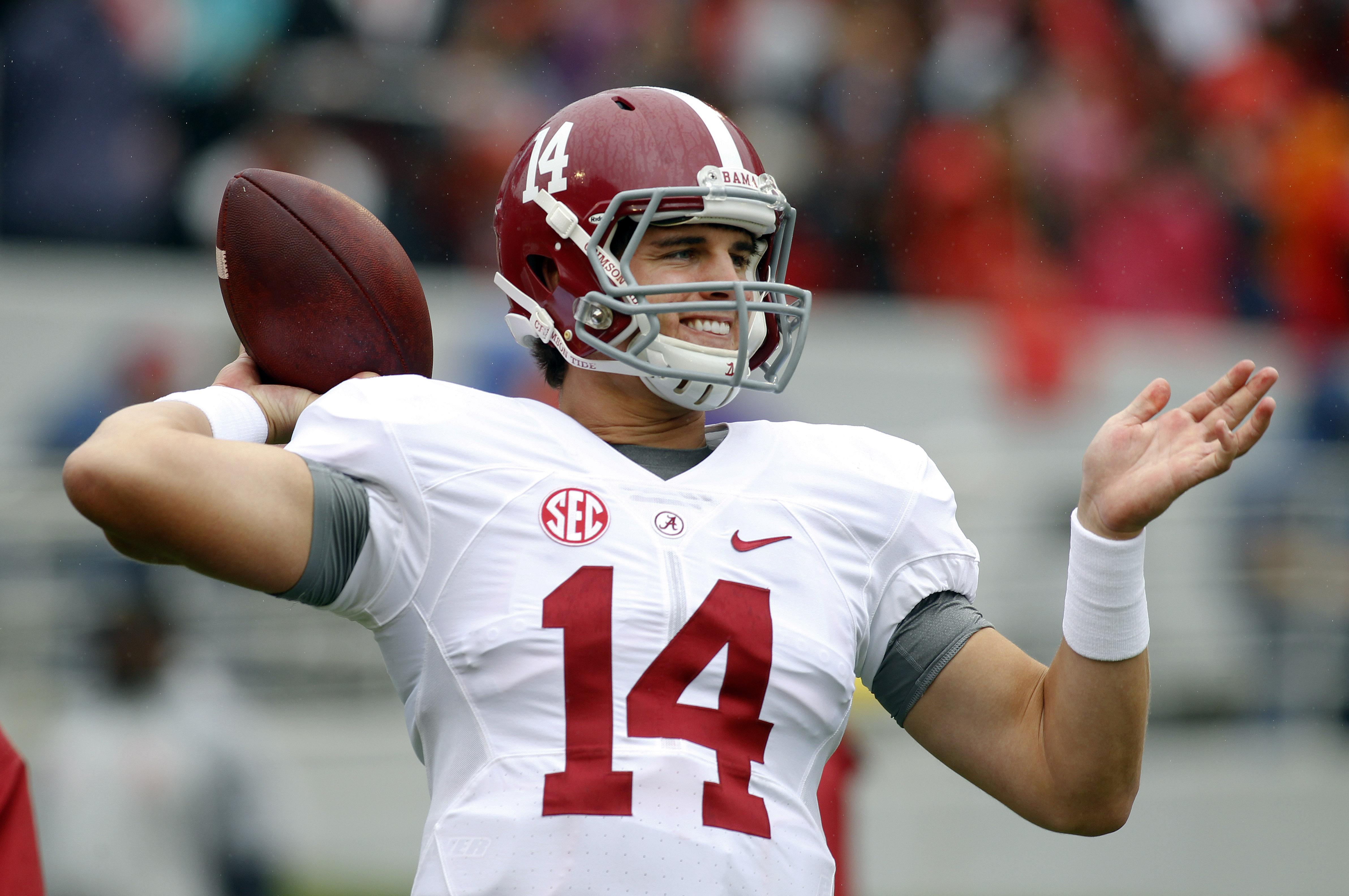 Alabama quarterback Jake Coker warms up before an NCAA college football game against Georgia, Saturday, Oct. 3, 2015, in Athens, Ga. (AP Photo/Brett Davis)