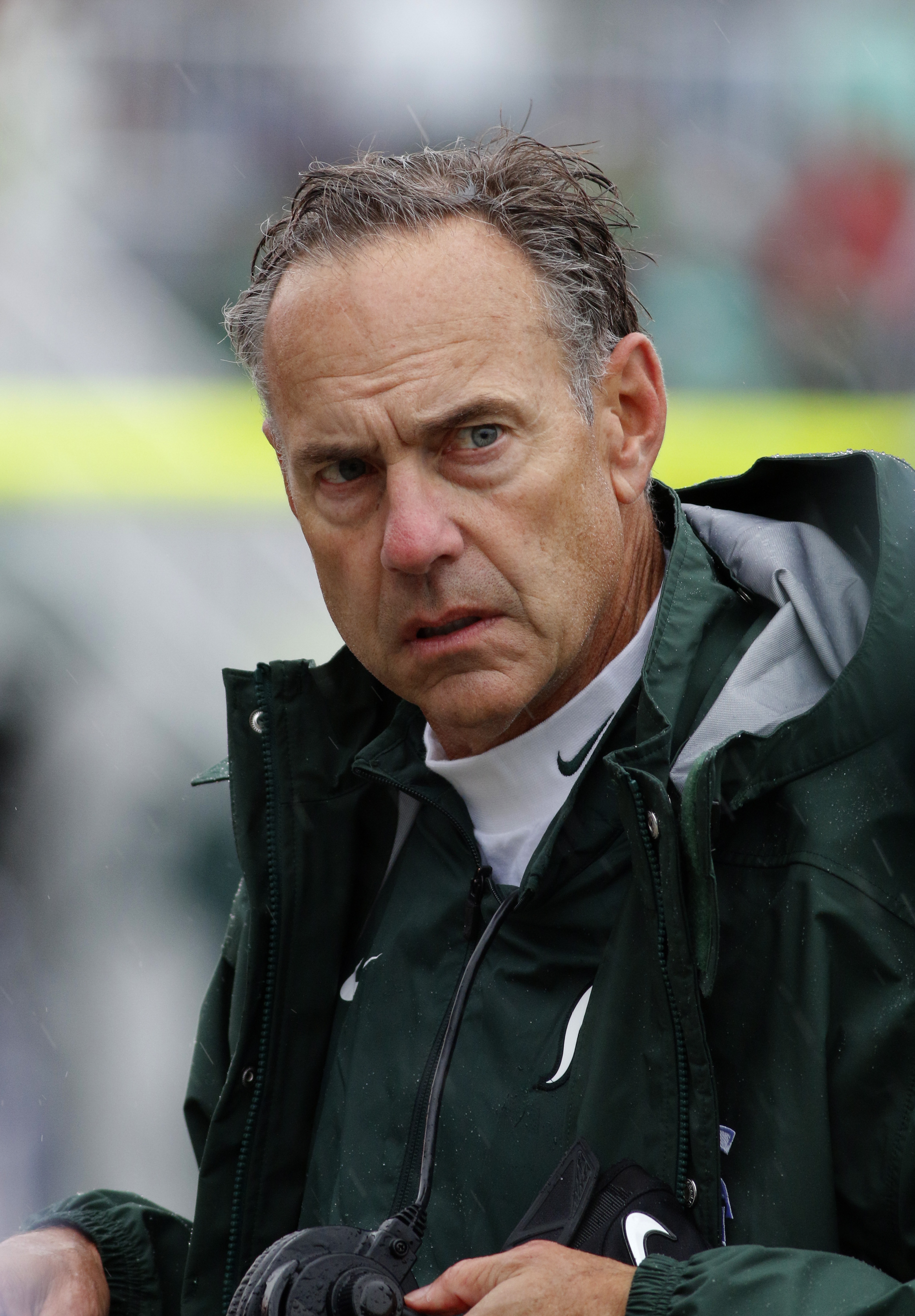 Michigan State coach Mark Dantonio loosk on from the sideline during the second quarter of an NCAA college football game against Purdue, Saturday, Oct. 3, 2015, in East Lansing, Mich. Michigan State won 24-21. (AP Photo/Al Goldis)