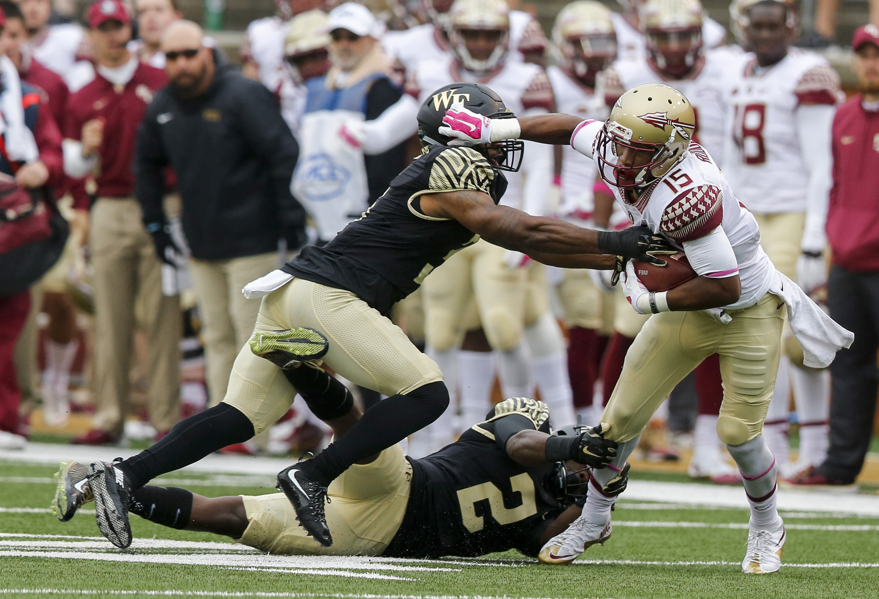 Florida State wide receiver Travis Rudolph (15) breaks free from Wake Forest defenders Cameron Glenn (2) and Devin Gaudin after a catch in the first half of an NCAA college football game in Winston-Salem, N.C., Saturday, Oct. 3, 2015. (AP Photo/Nell Redmo