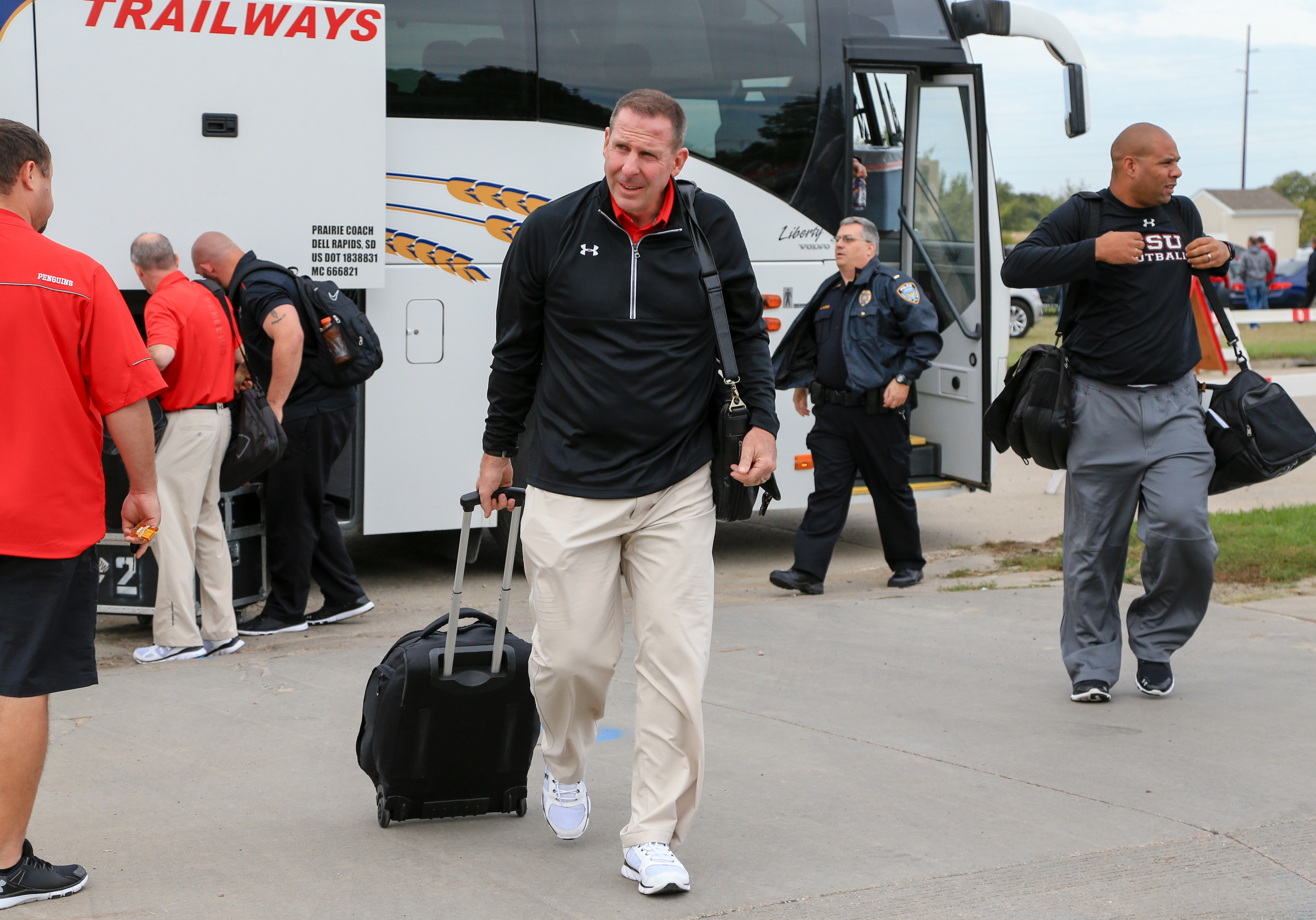 Youngstown State head coach Bo Pelini arrives to the Dakotadome before an NCAA college football game against South Dakota, in Vermillion, S.D., Saturday, Oct. 3, 2015. Vermillion lies seven miles north of the Nebraska state line, an area deep within the H