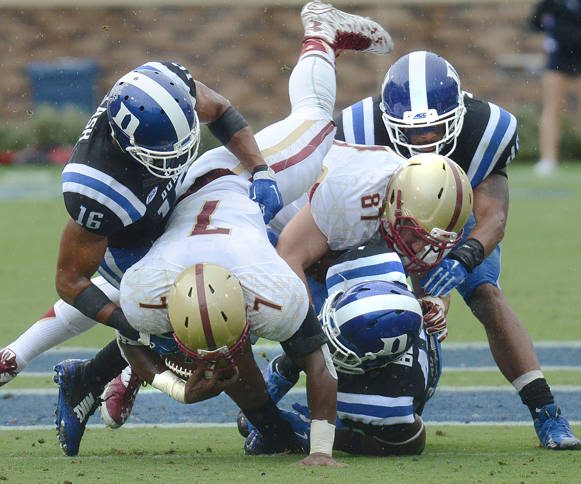 Duke's Jeremy Cash (16) takes down Boston College's Marcus Outlow (7) during an NCAA college football game in Durham, N.C., Saturday, Oct. 3, 2015. (Bernard Thomas/The Herald-Sun via AP)