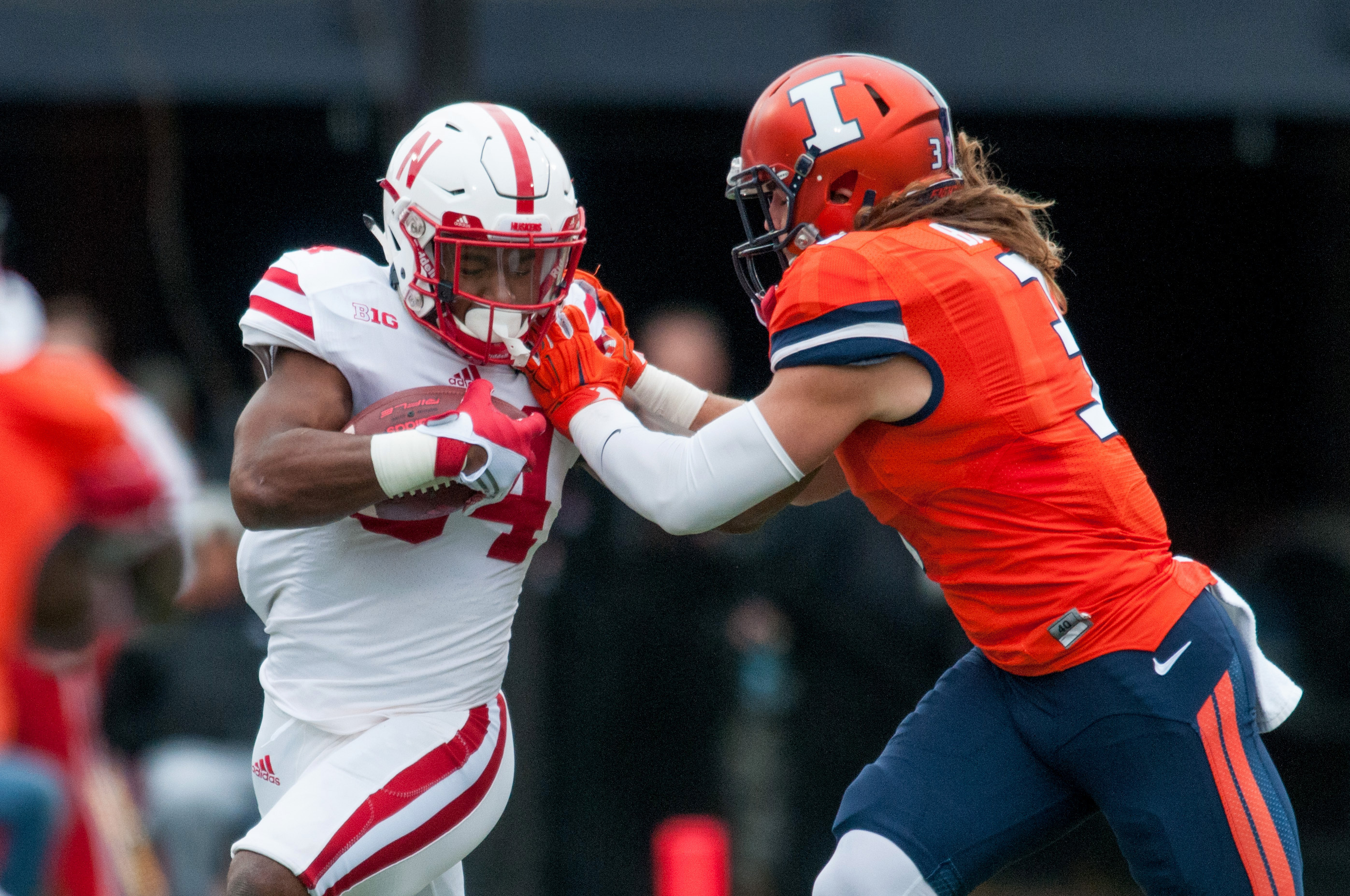 Nebraska running back Terrell Newby (34) tries to avoid a tackle by Illinois defensive back Taylor Barton (3) during the first quarter of an NCAA football game Saturday, Oct. 3, 2015, at Memorial Stadium in Champaign, Ill.  (AP Photo/Bradley Leeb)
