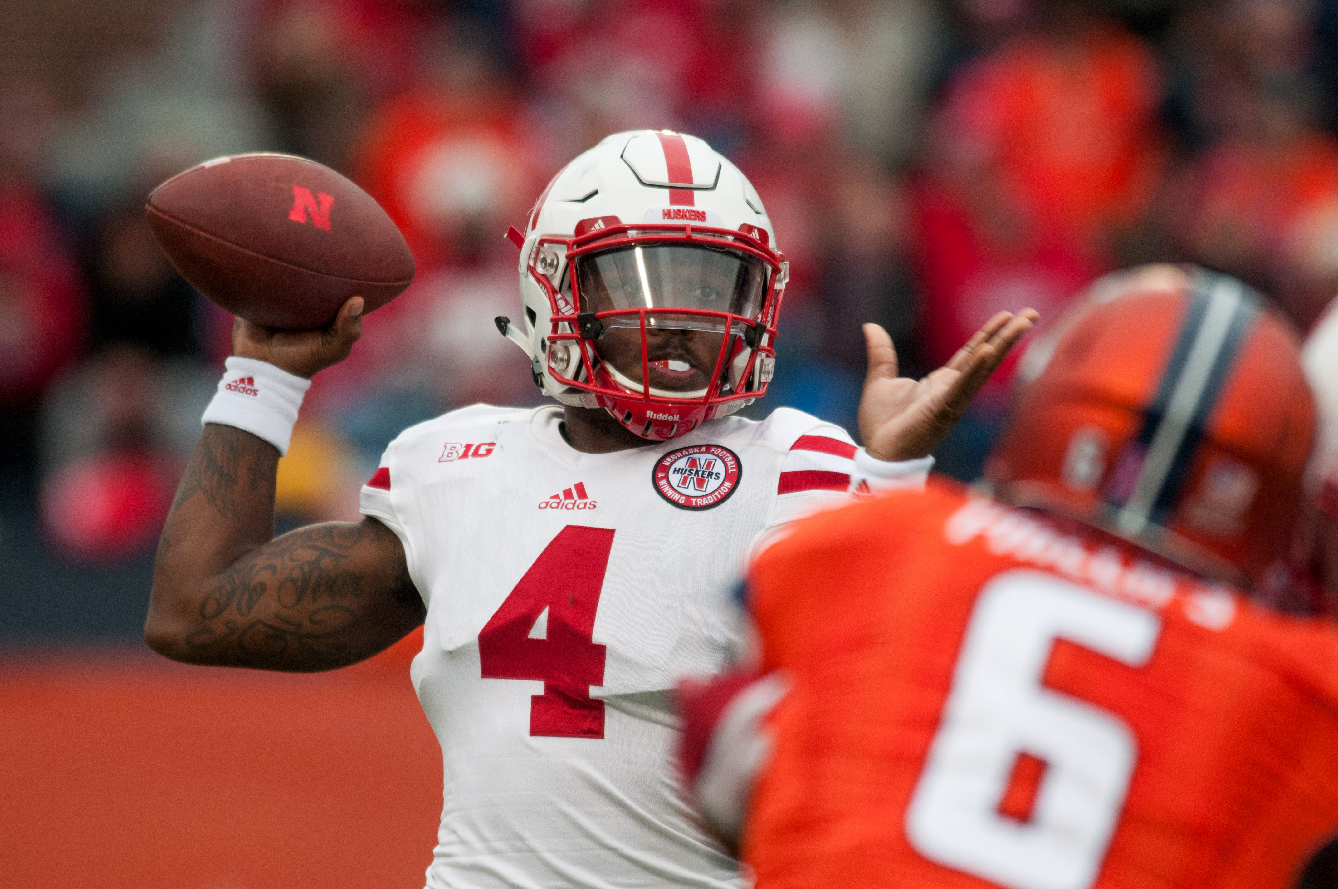 Nebraska quarterback Tommy Armstrong Jr. (4) throws during the first half of an NCAA college football game against Illinois Saturday, Oct. 3, 2015, in Champaign, Ill.  Illinois won 14-13. (AP Photo/Bradley Leeb)
