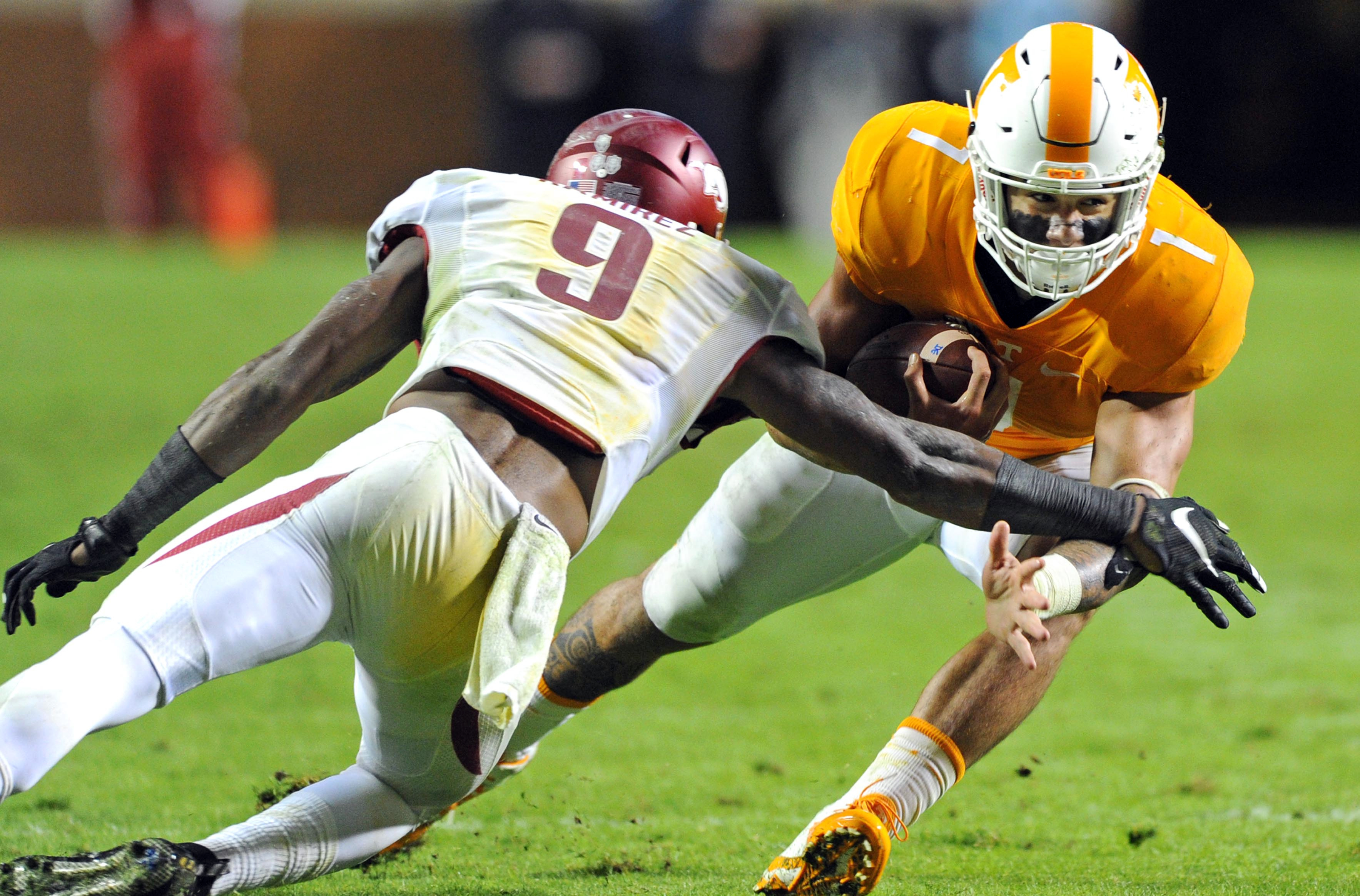 Tennessee running back Jalen Hurd (1) runs the ball against Arkansas defensive back Santos Ramirez (9) during the first half of an NCAA college football game at Neyland Stadium in Knoxville, Tenn. on Saturday, Oct. 3, 2015. (Michael Patrick/Knoxville News