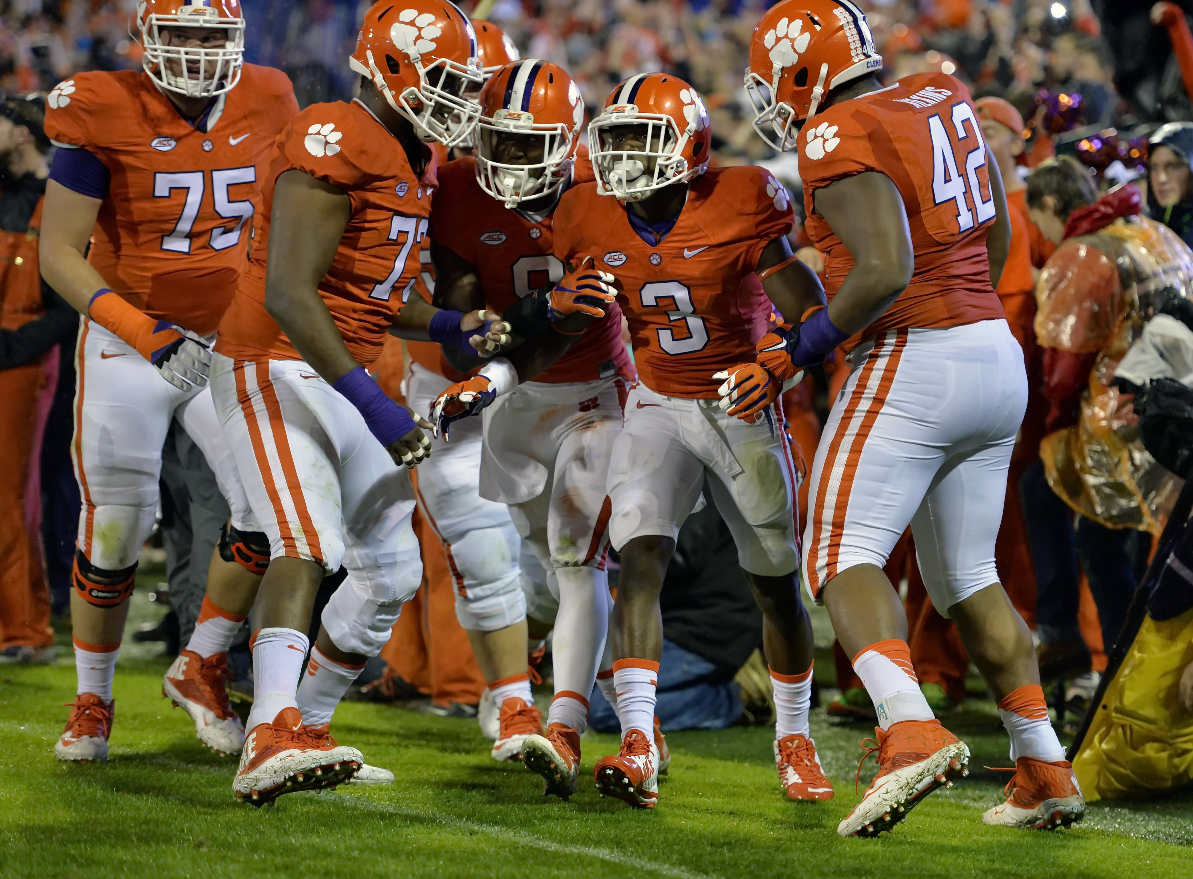 Clemson's Artavis Scott celebrates his touchdown with his teammates during the first half of an NCAA college football game against Notre Dame, Saturday, Oct. 3, 2015, in Clemson, S.C. (AP Photo/Richard Shiro)
