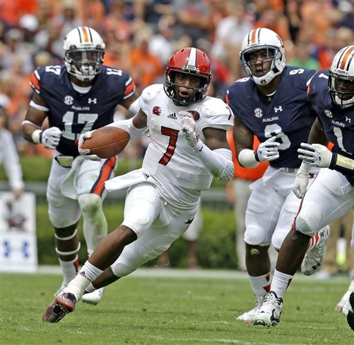 Jacksonville State quarterback Eli Jenkins (7) scrambles for a first down during the second half of an NCAA college football game against Auburn, Saturday, Sept. 12, 2015, in Auburn, Ala. (AP Photo/Butch Dill)