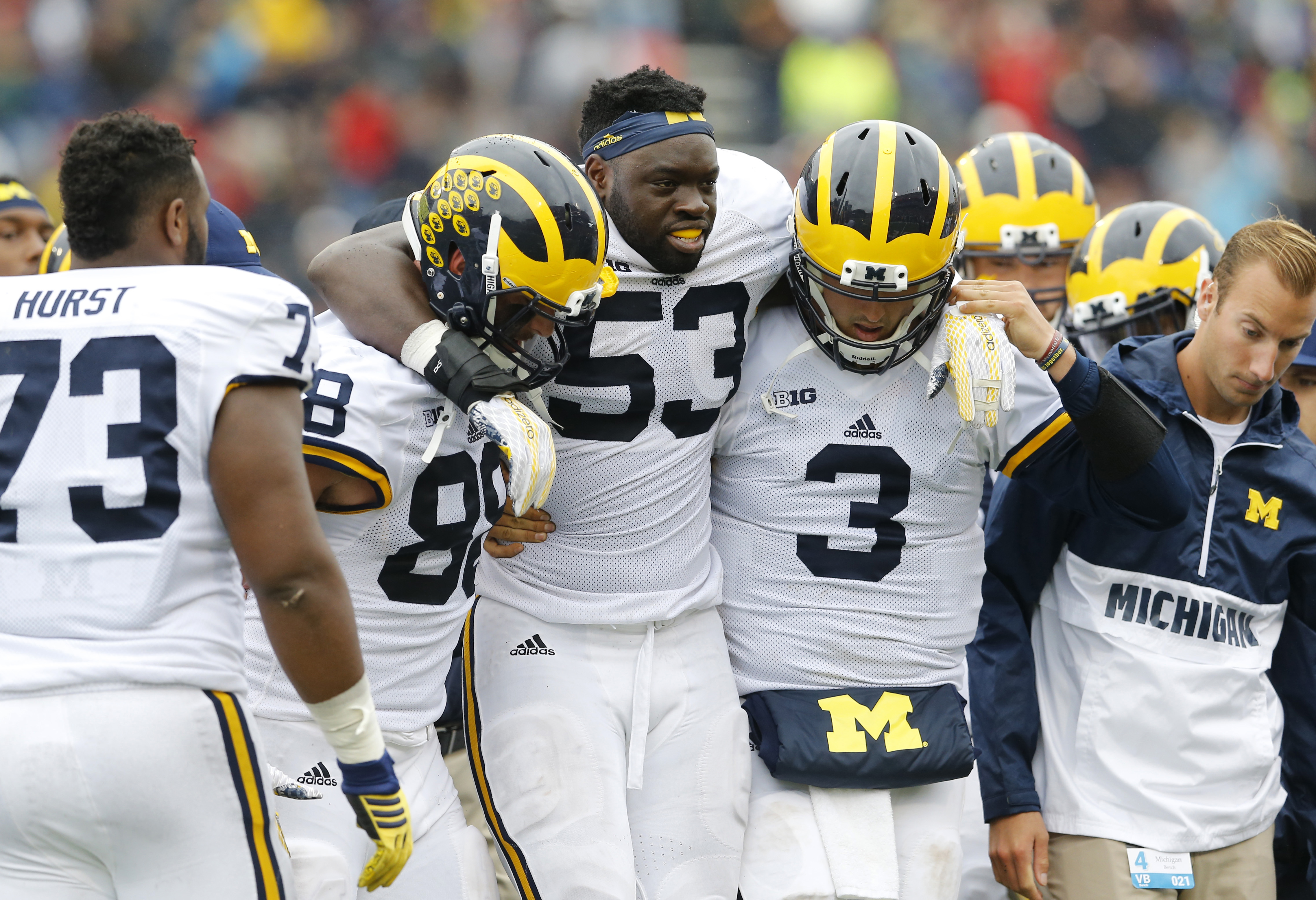 Michigan defensive end Mario Ojemudia (53) is assisted off the field after injuring himself on a play in the second half of an NCAA college football game against Maryland, Saturday, Oct. 3, 2015, in College Park, Md. (AP Photo/Patrick Semansky)