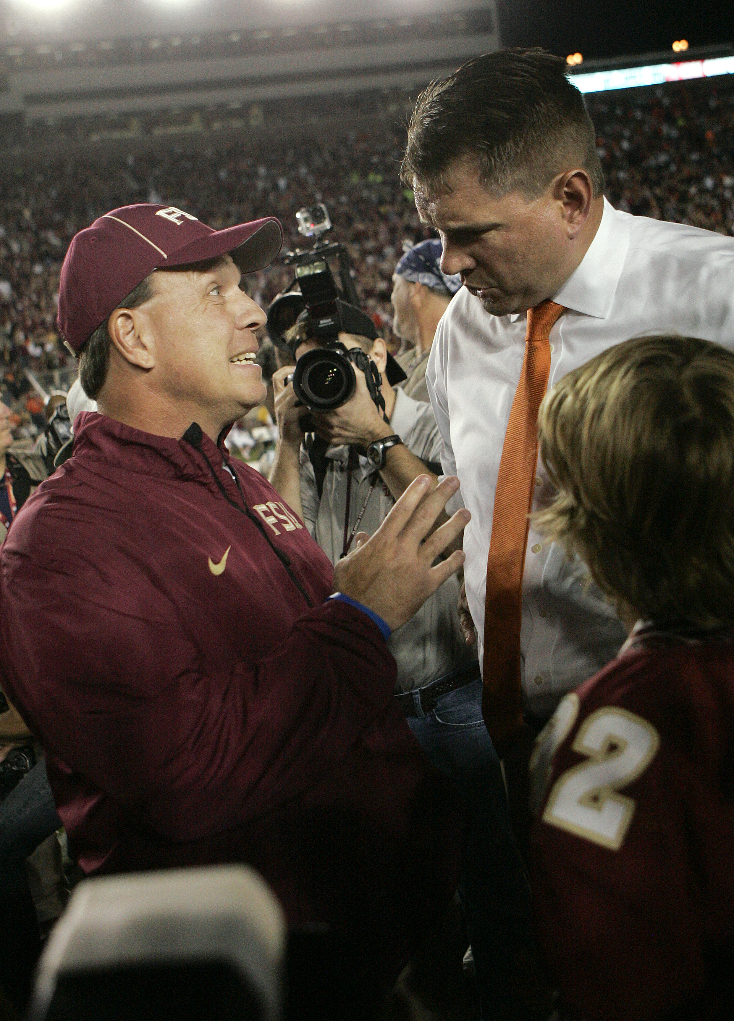 FILE - In this Nov. 2, 2013, file photo, Miami head coach Al Golden, right, talks to Florida State head coach Jimbo Fisher before the start of an NCAA college football game in Tallahassee, Fla. Florida State and Miami play Saturday, Oct. 10, 2015, in Tall