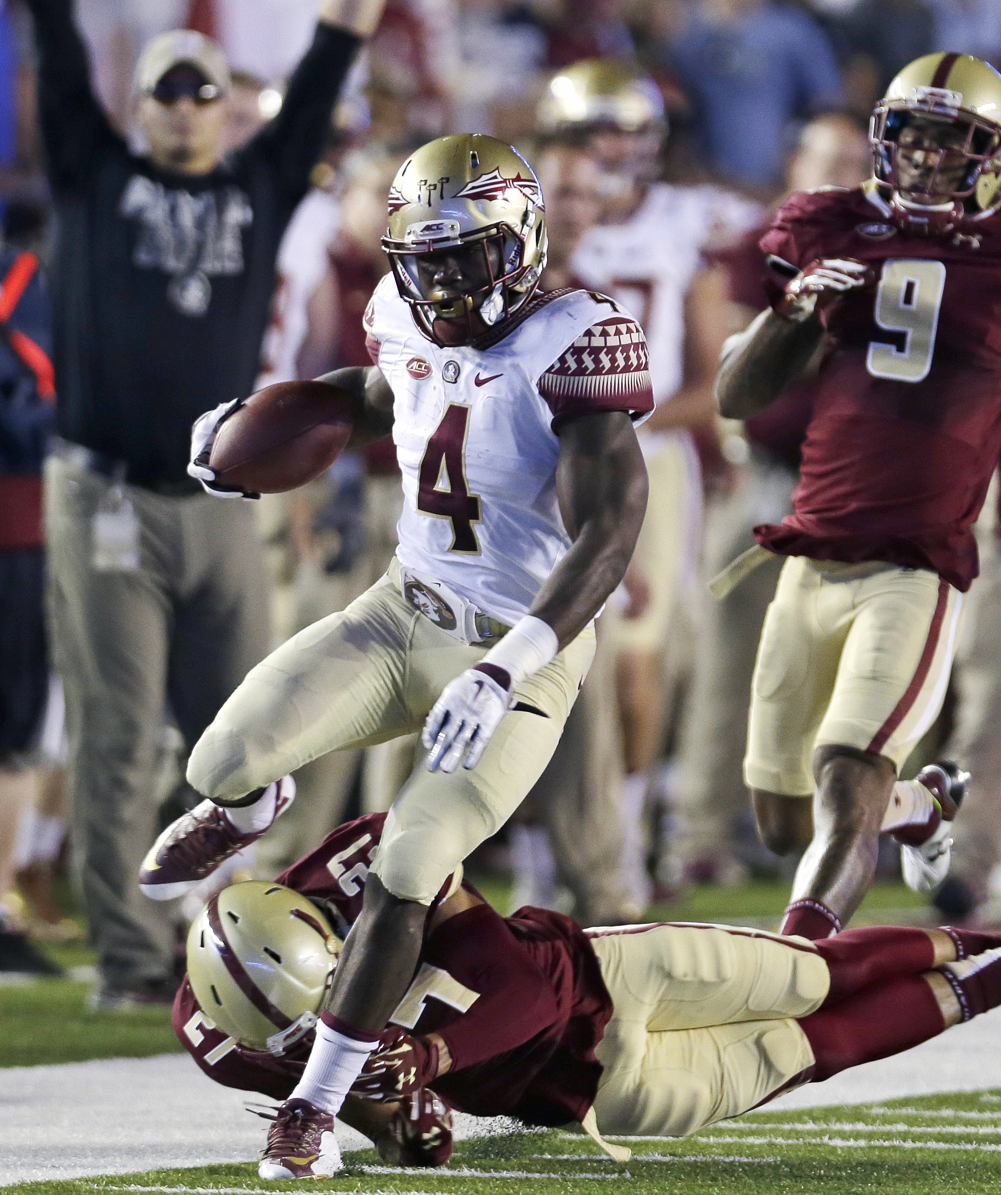 FILE - In this Sept. 18, 2015, file photo, Florida State running back Dalvin Cook (4) tries to outrun Boston College defensive back Justin Simmons (27) and defensive back John Johnson (9) during the first half of an NCAA college football game in Boston. F