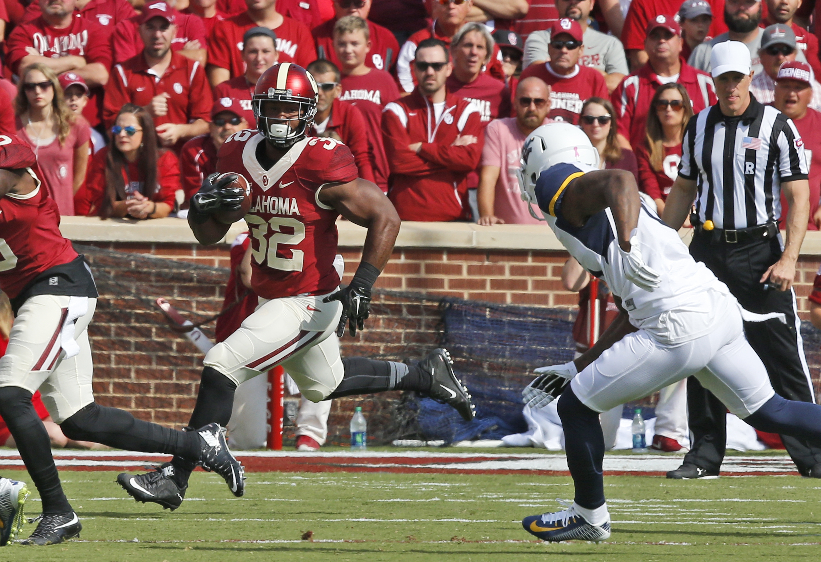 FILE - In this Oct. 3, 2015, file photo, Oklahoma running back Samaje Perine (32) carries against West Virginia during an NCAA college football game in Norman, Okla. Nearly half his yards have come in the fourth quarter, when the 230-pound bruiser can pun