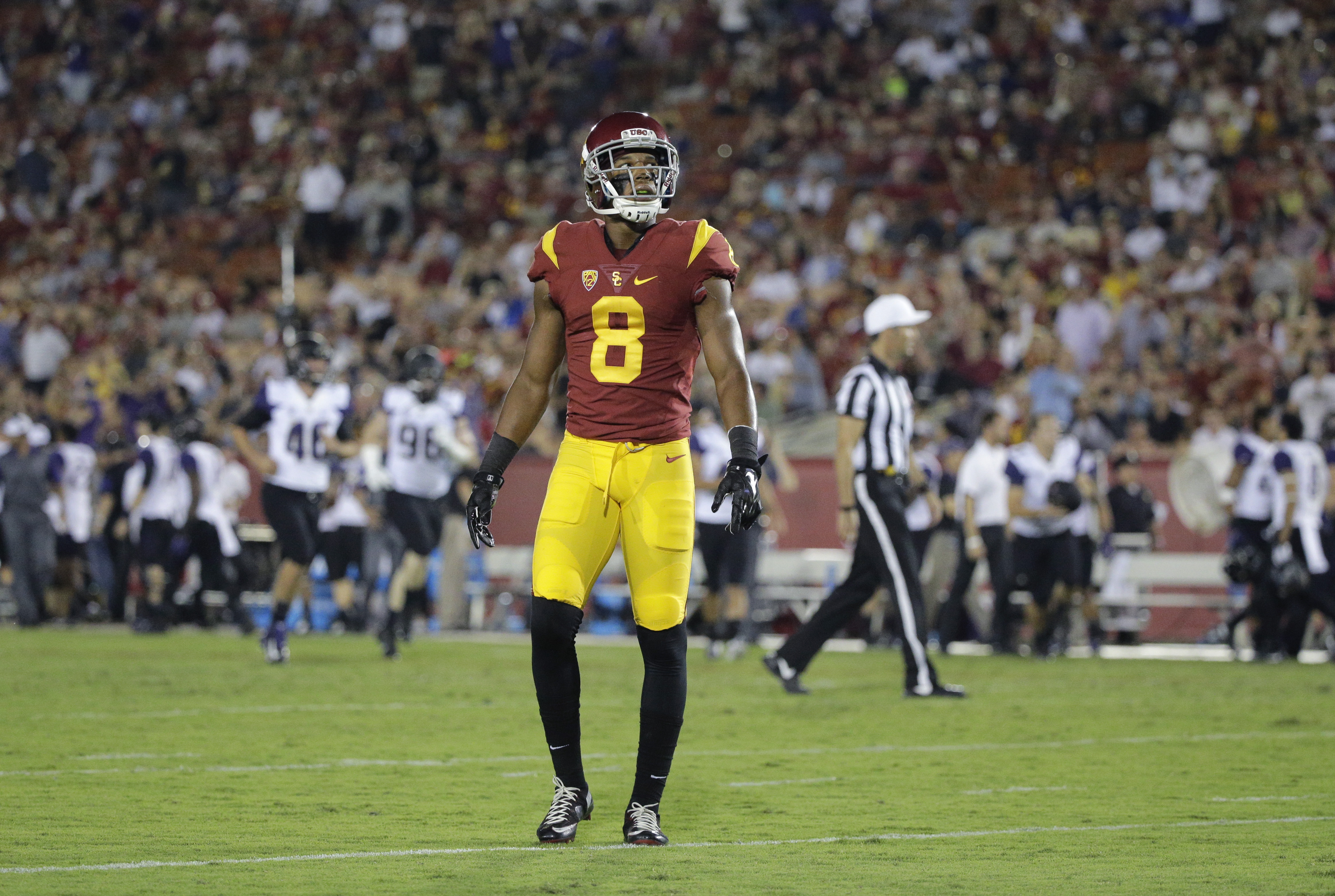 Southern California's Iman Marshall looks at the scoreboard as Washington players celebrate a touchdown by Joshua Perkins during the second half of an NCAA college football game, Thursday, Oct. 8, 2015, in Los Angeles. Washington won 17-12. (AP Photo/Jae