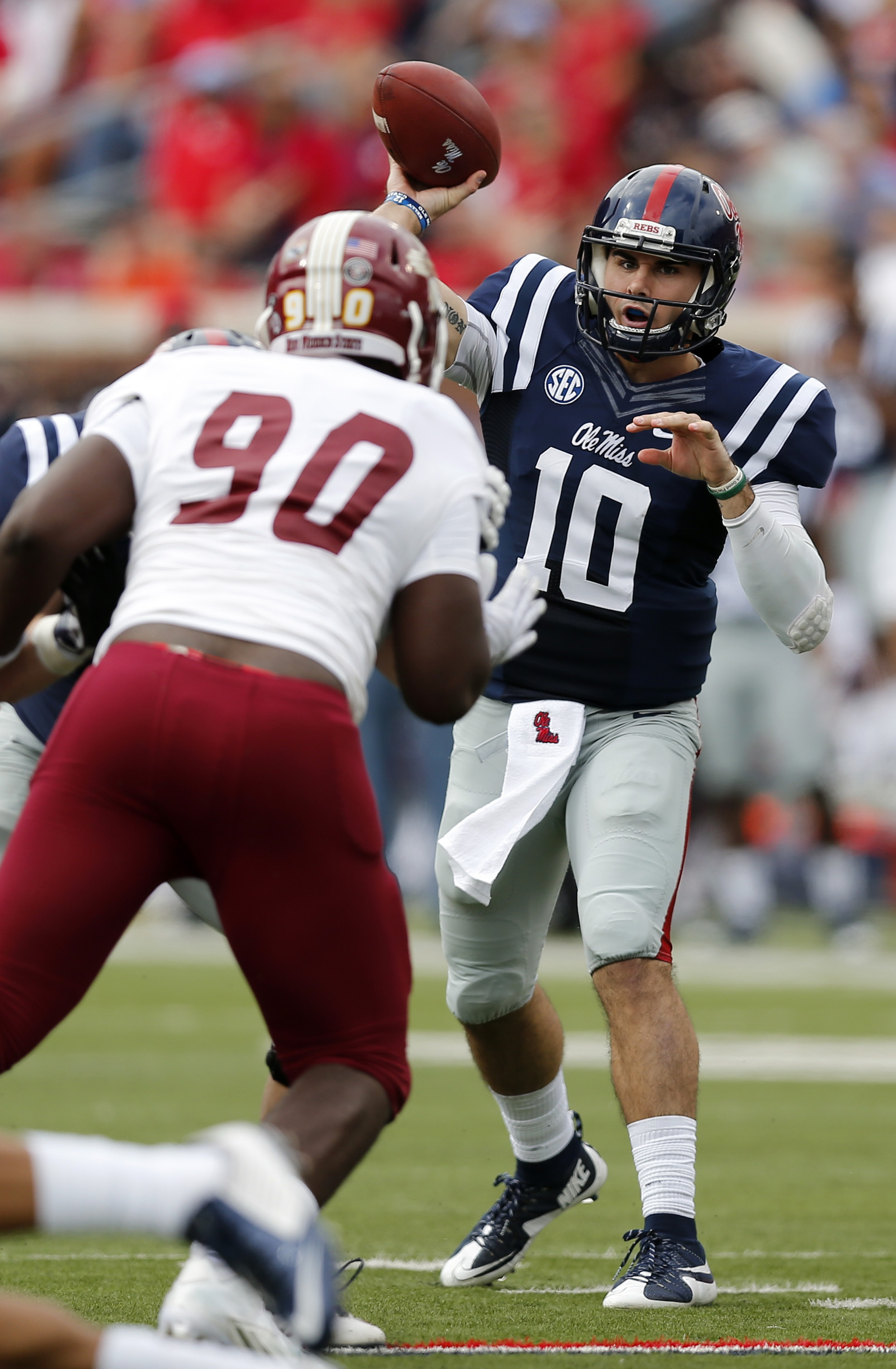 Mississippi quarterback Chad Kelly (10) passes against New Mexico State defensive lineman Kourtland Busby (90) during the first half of an NCAA college football game in Oxford, Miss., Saturday, Oct. 10, 2015. (AP Photo/Rogelio V. Solis)