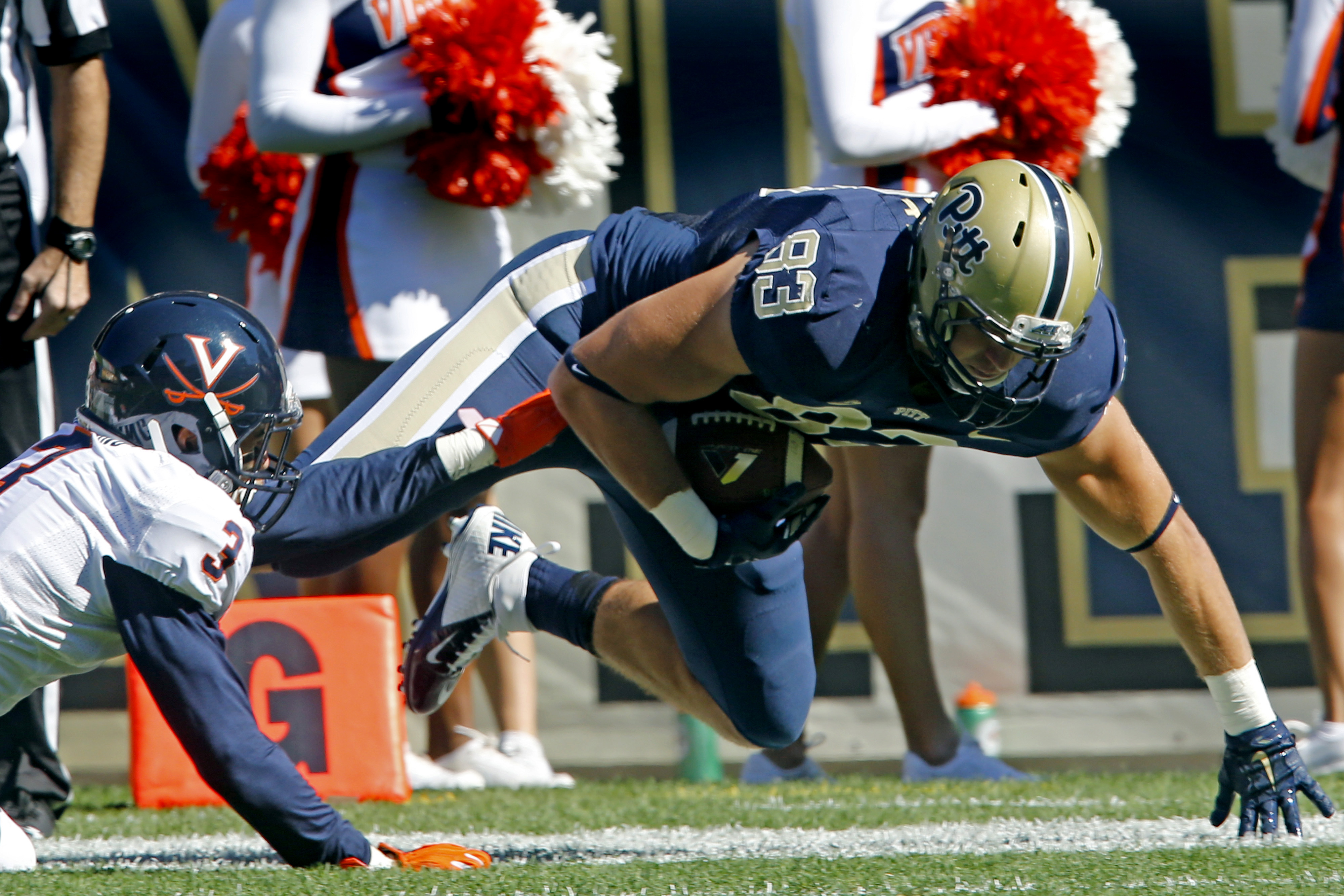 Pittsburgh tight end Scott Orndoff (83) gets away from Virginia safety Quin Blanding (3) after making a catch to score in the first quarter of an NCAA college football game, Saturday, Oct. 10, 2015 in Pittsburgh. (AP Photo/Keith Srakocic)