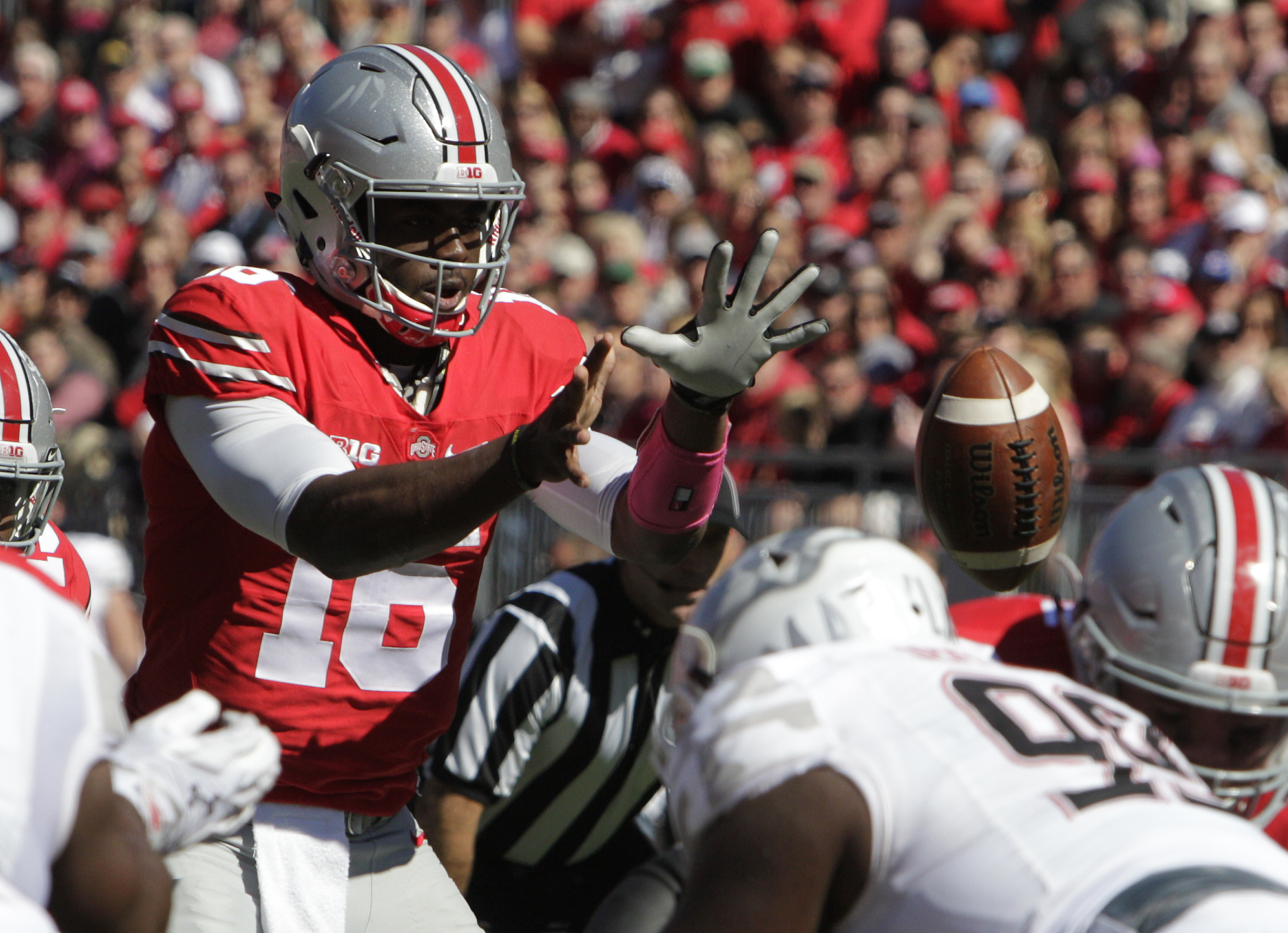 Ohio State quarterback J.T. Barrett takes a snap against Maryland during the second quarter of an NCAA college football game Saturday, Oct. 10, 2015, in Columbus, Ohio. (AP Photo/Jay LaPrete)