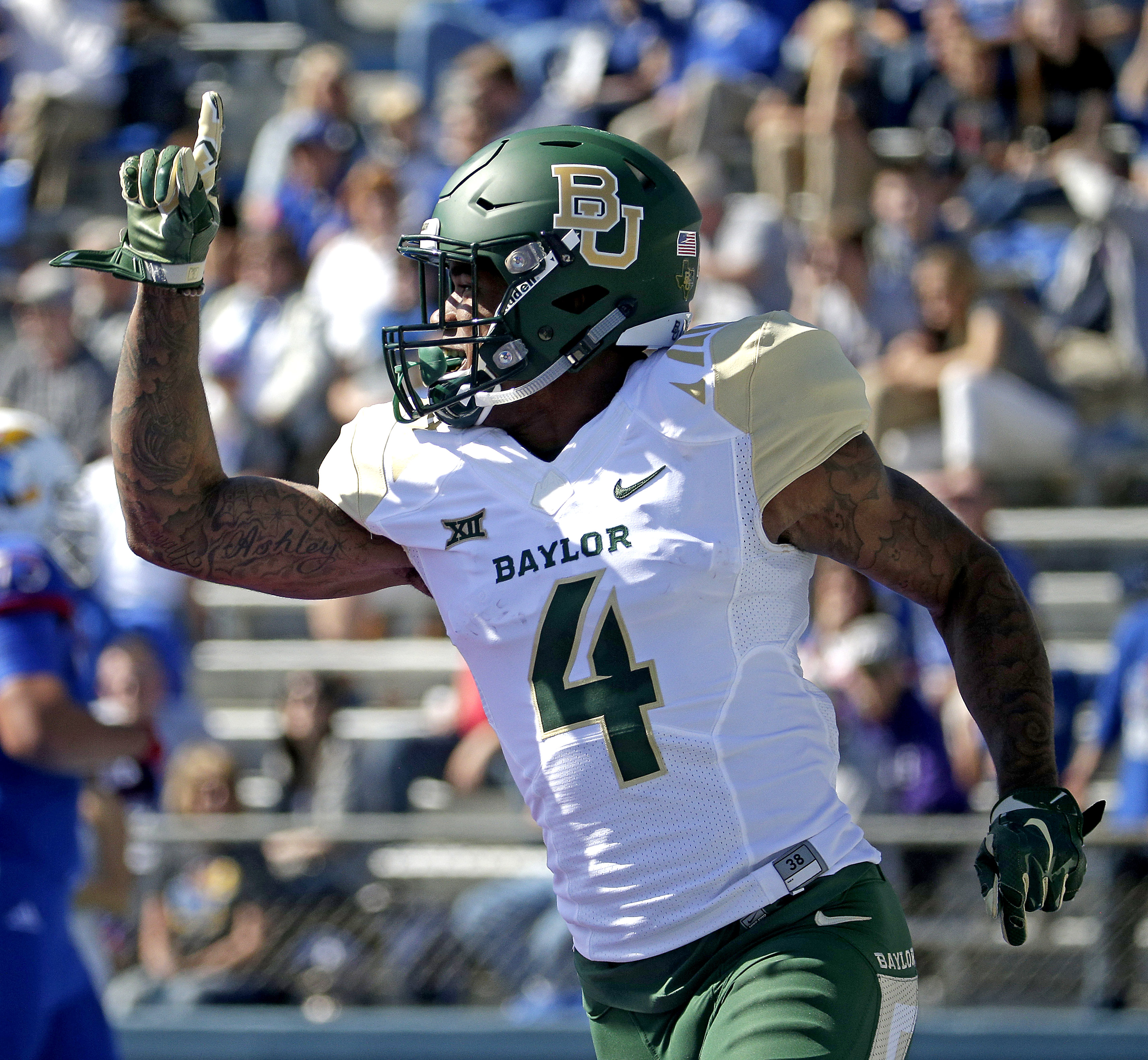 Baylor cornerback Xavien Howard celebrates after recovering a Kansas fumble and running the ball in for a touchdown during the first half of an NCAA college football game, Saturday, Oct. 10, 2015, in Lawrence, Kan. (AP Photo/Charlie Riedel)