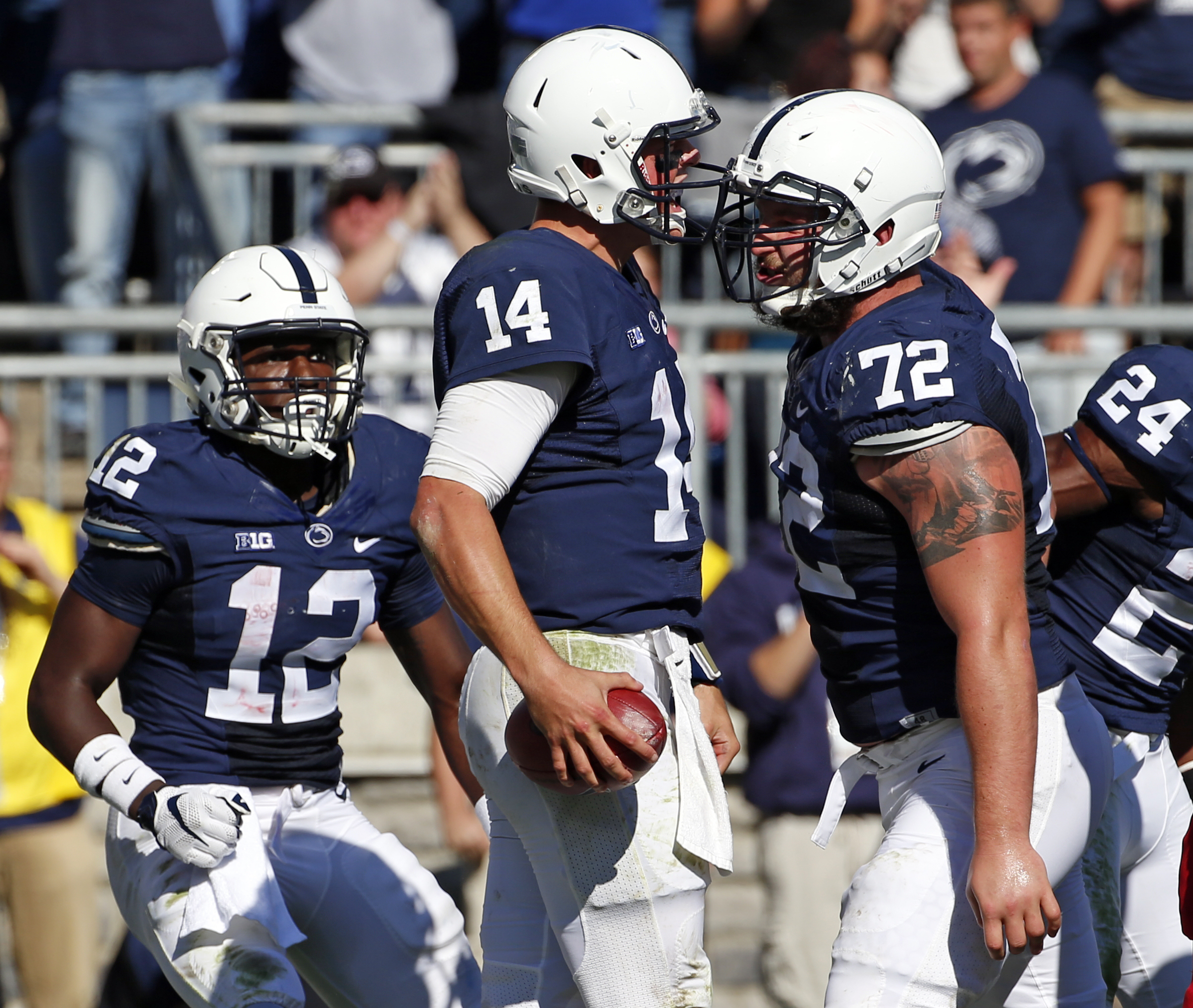 Penn State quarterback Christian Hackenberg (14) celebrates with teammates after scoring a touchdown on a 5-yard scramble up the middle in the second half of an NCAA college football game against Indiana in State College, Pa., Saturday, Oct. 10, 2015. (AP