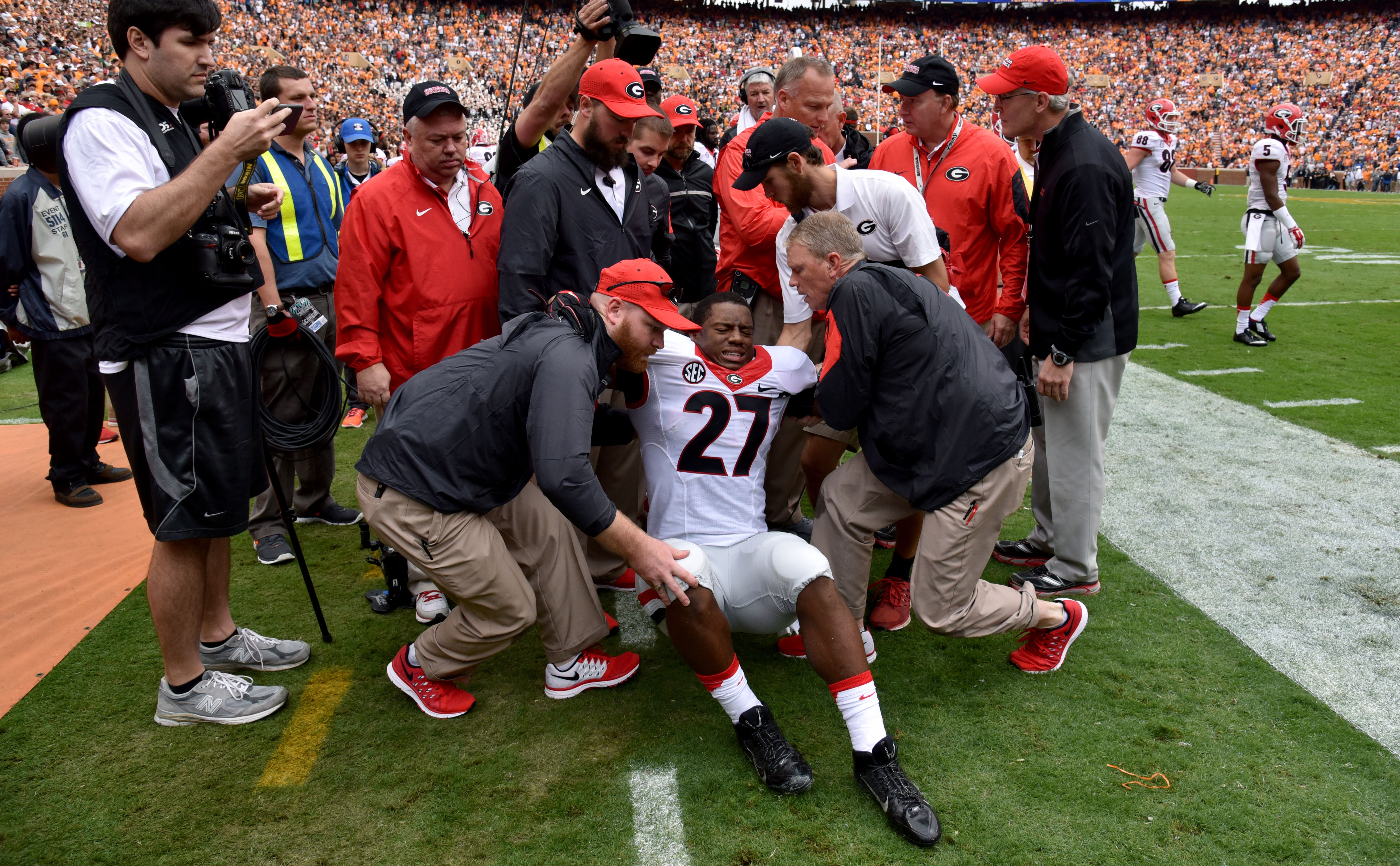 Georgia running back Nick Chubb is helped off the field after injuring his left knee on the first play from scrimmage during an NCAA college football game against Tennessee, Saturday, Oct. 10, 2015, in Knoxville, Tenn.  (Brant Sanderlin/Atlanta Journal-Co