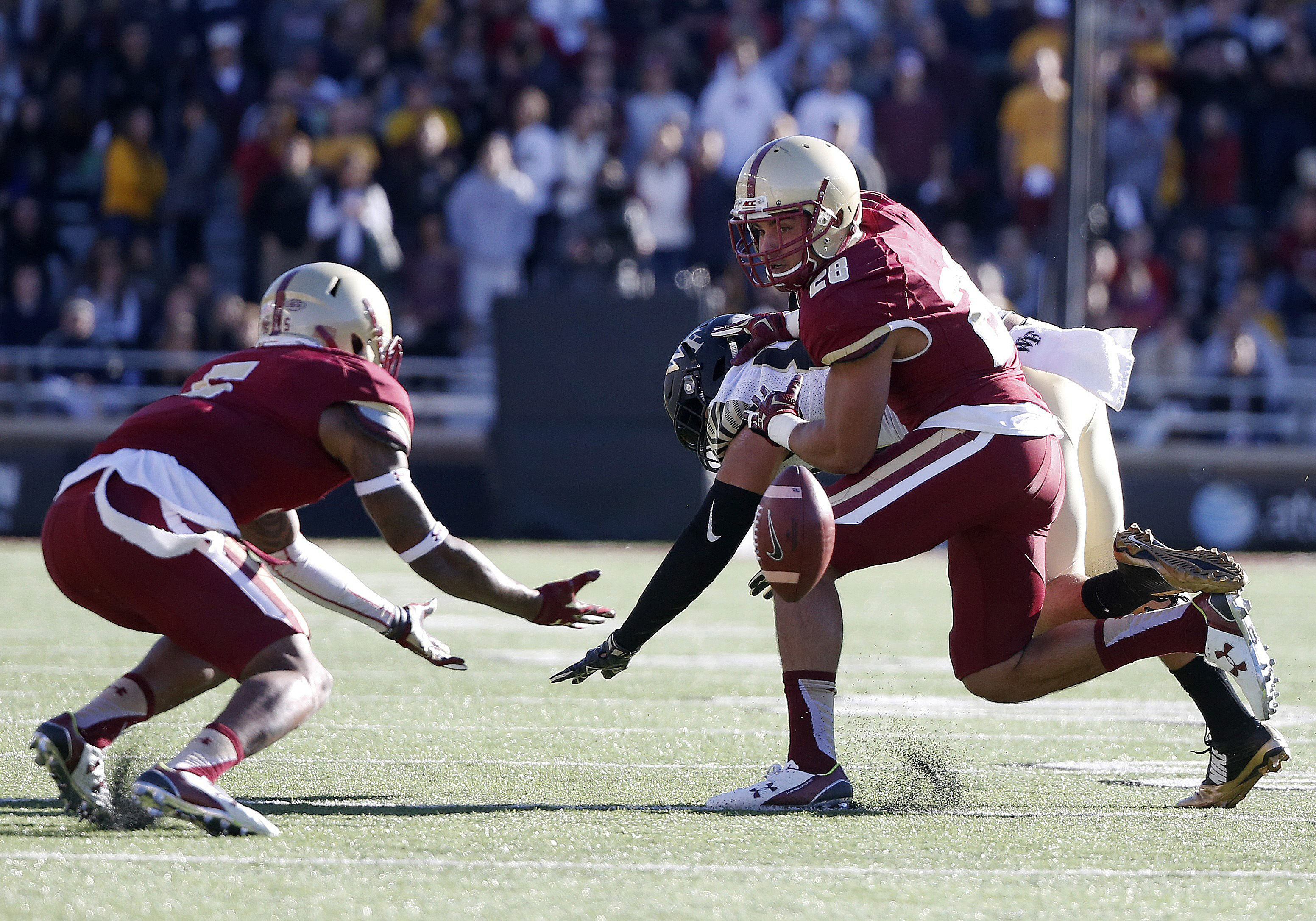 Boston College linebacker Matt Milano (28) breaks up a pass intended for Wake Forest wide receiver K.J. Brent, behind, during the second quarter of an NCAA college football game in Boston, Saturday, Oct. 10, 2015. (AP Photo/Michael Dwyer)