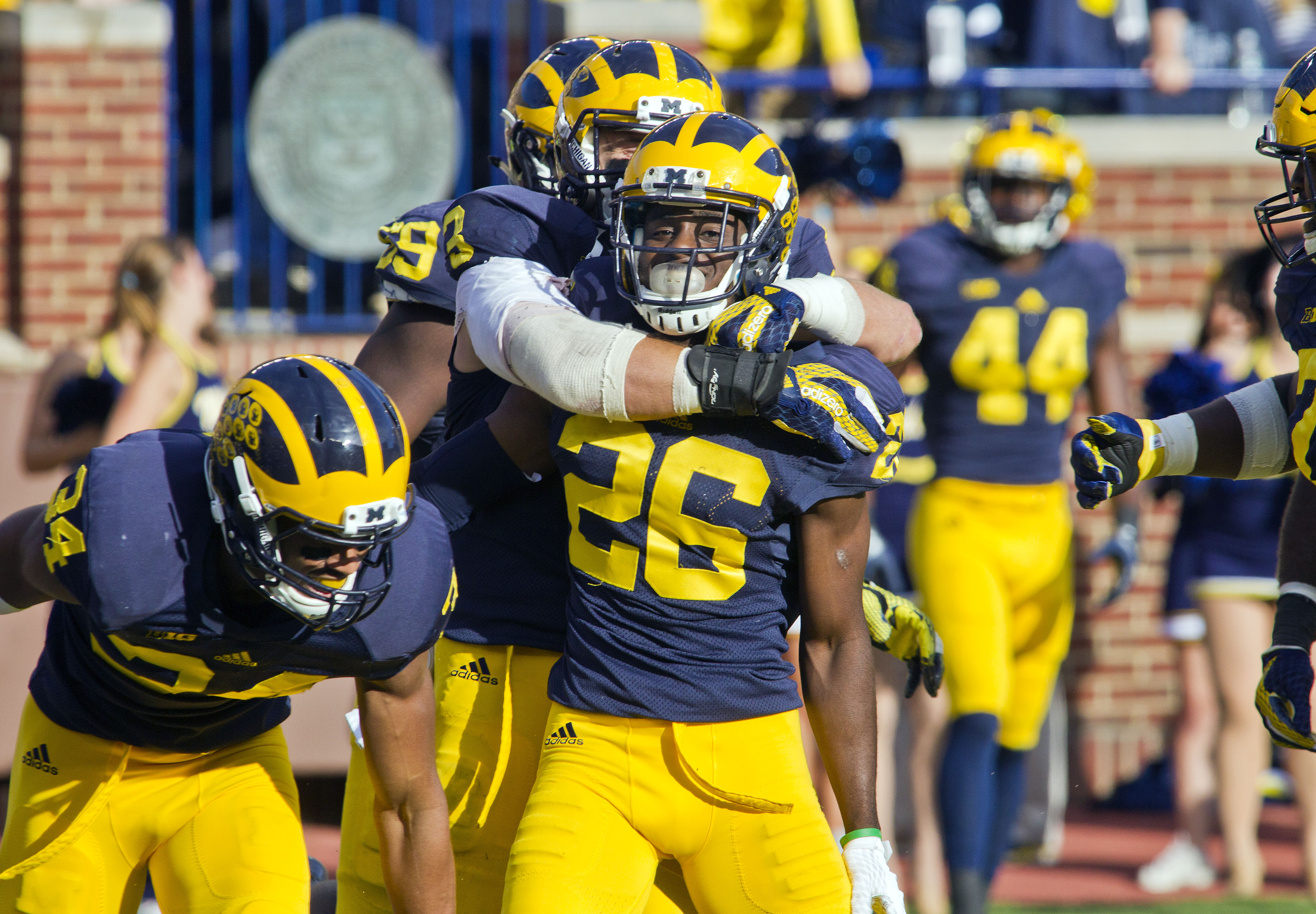 Michigan defensive back Jourdan Lewis (26) celebrates with teammates after scoring a touchdown on an interception in the second quarter of an NCAA college football game against Northwestern in Ann Arbor, Mich., Saturday, Oct. 10, 2015. (AP Photo/Tony Ding