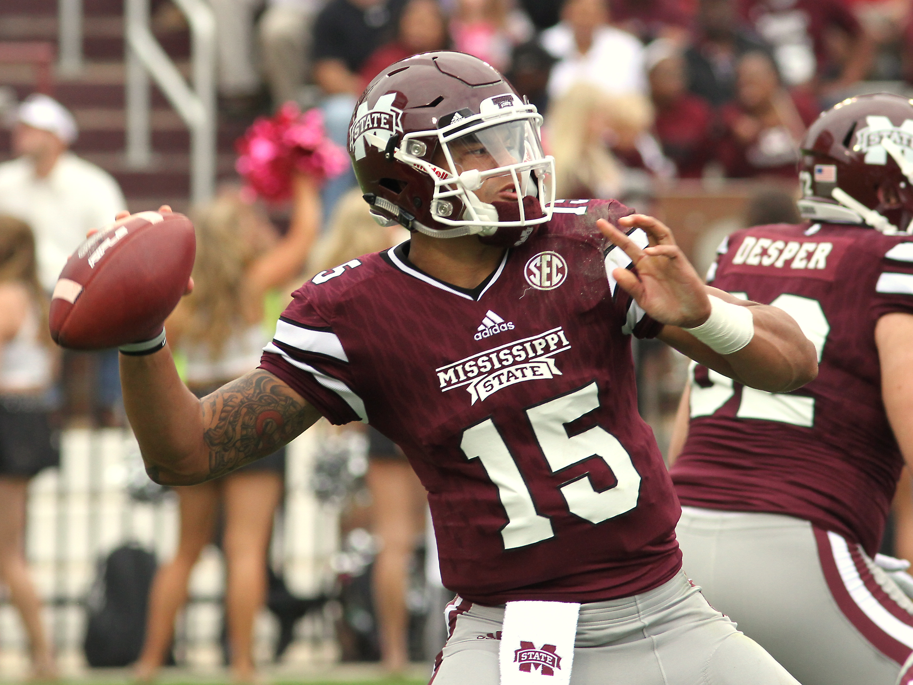 Mississippi State quarterback Dak Prescott (15) prepares to throw a pass during the first half of an NCAA college football game against Troy in Starkville, Miss., Saturday, Oct. 10, 2015.(AP Photo/Jim Lytle)