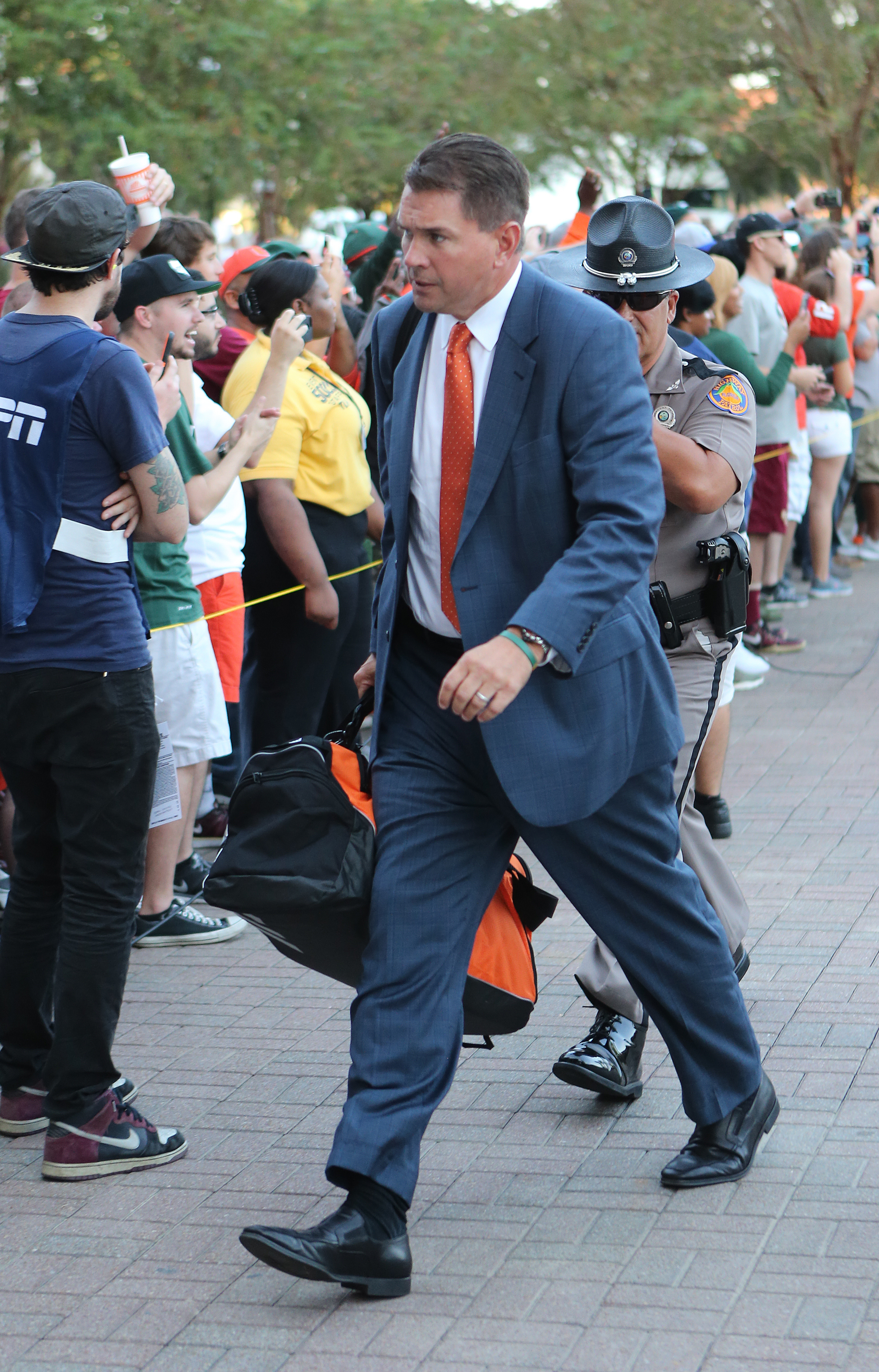 Miami's head coach Al Golden leads his team into Doak Campbell Stadium prior to the start of an NCAA college football game with Florida State, Saturday, Oct. 10, 2015 in Tallahassee, Fla. (AP Photo/Steve Cannon)