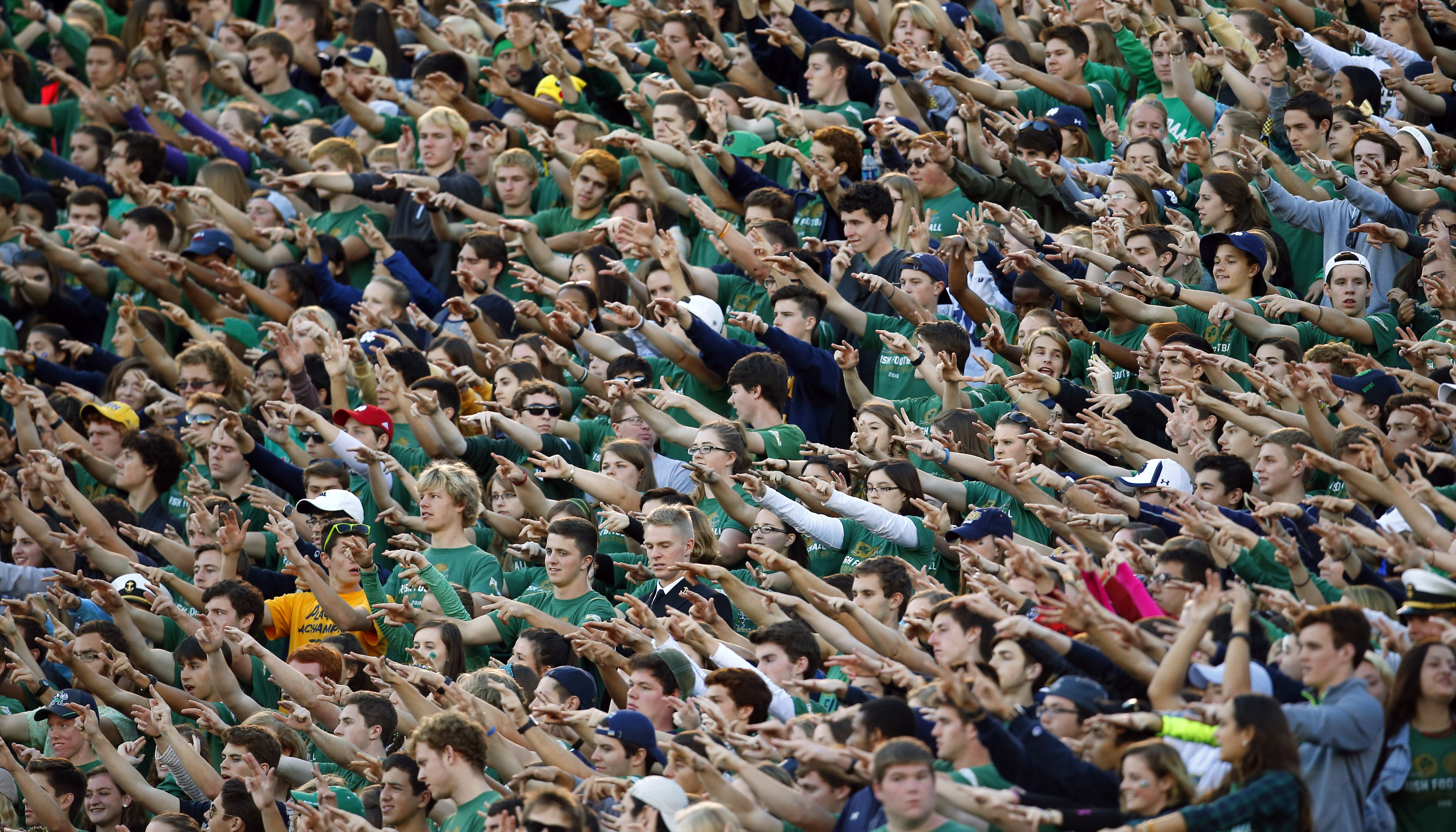 The Notre Dame student section waves their arms at the start of the fourth quarter of an NCAA college football game against Navy, Saturday, Oct. 10, 2015, in South Bend, Ind. Notre Dame won the game 41-24. (AP Photo/Jeff Haynes)