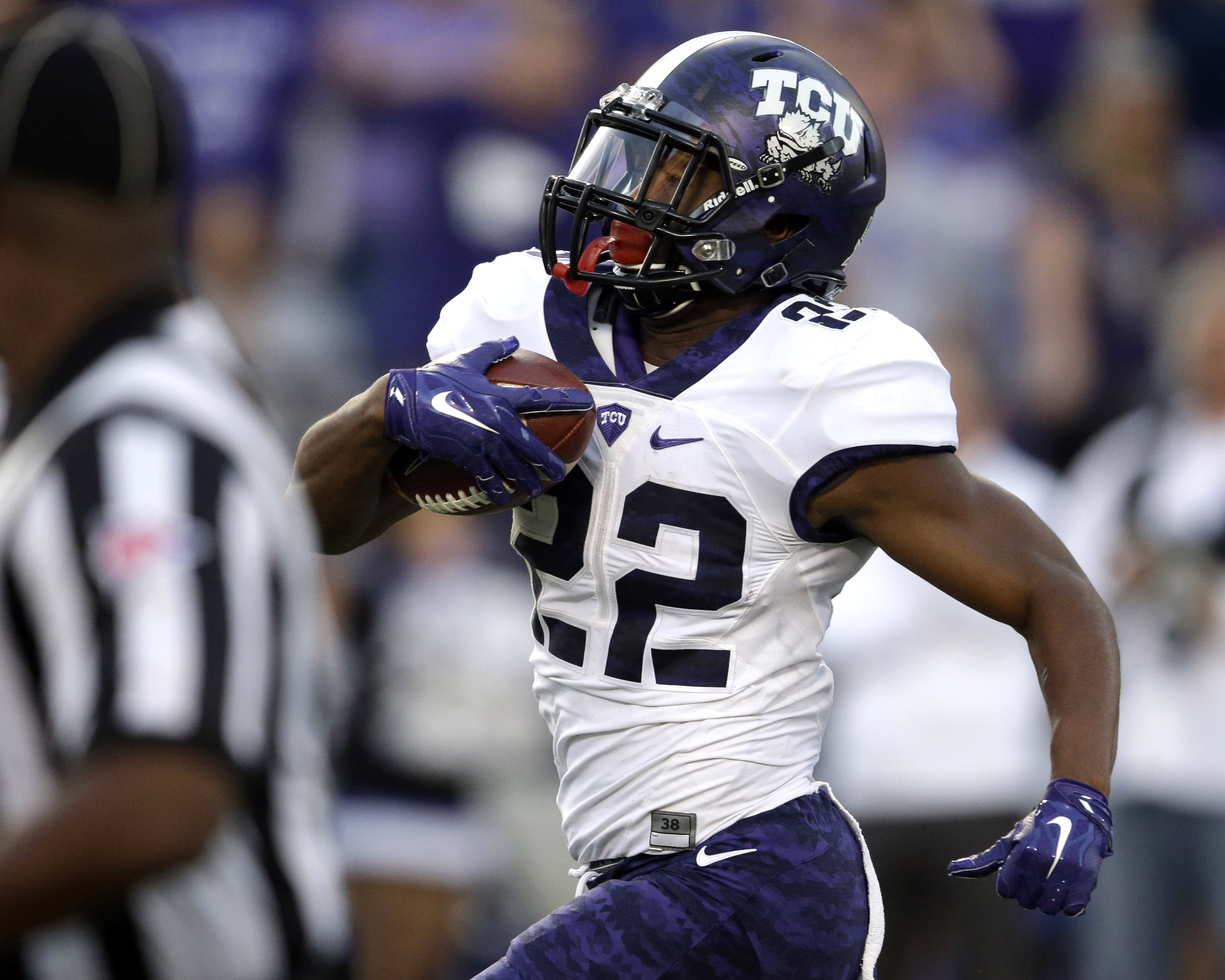TCU running back Aaron Green (22) runs for a touchdown during the first half of an NCAA college football game against Kansas State in Manhattan, Kan., Saturday, Oct. 10, 2015. (AP Photo/Orlin Wagner)