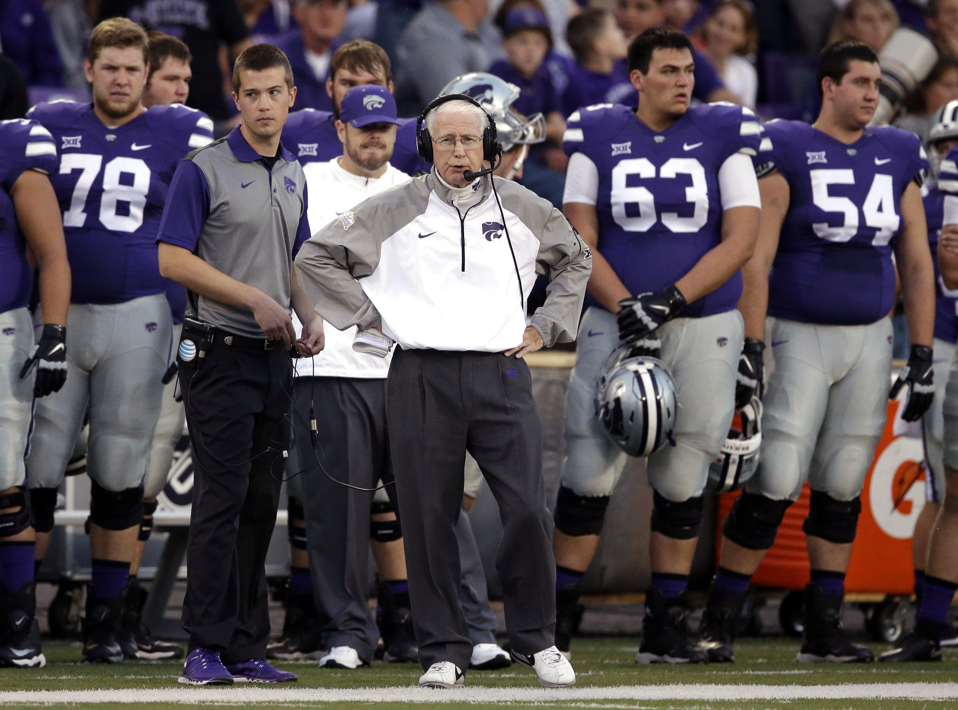 Kansas State head coach Bill Snyder, center, stands with his team during the first half of an NCAA college football game against TCU in Manhattan, Kan., Saturday, Oct. 10, 2015. (AP Photo/Orlin Wagner)