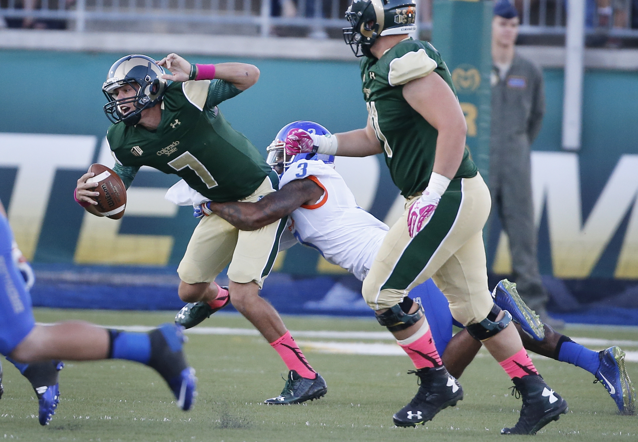 Colorado State quarterback Nick Stevens (7) is sacked by Boise State safety Chanceller James (3) in the first half of an NCAA college football game Saturday, Oct. 10, 2015, in Fort Collins, Colo. (AP Photo/Brennan Linsley)