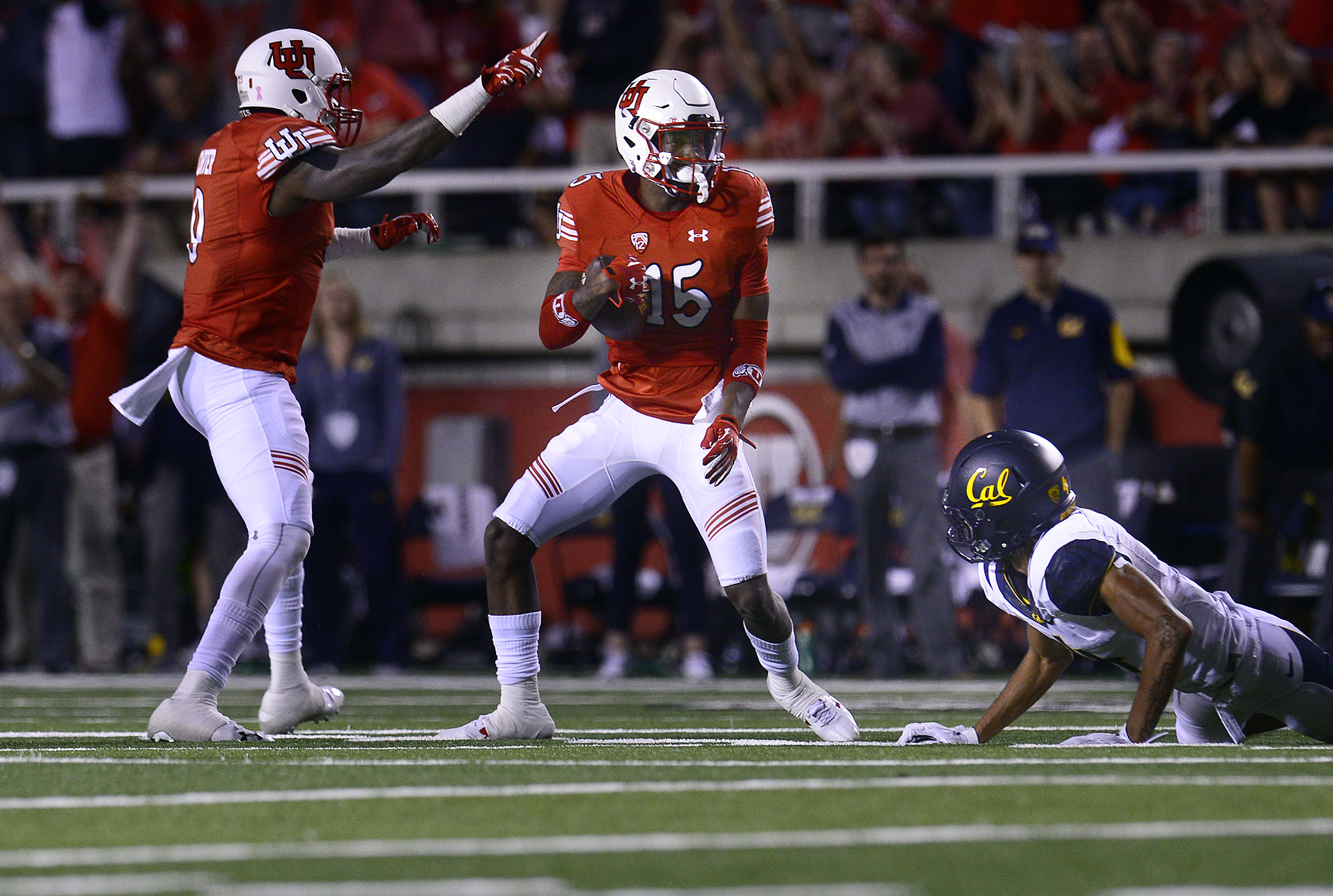 Utah's Dominique Hatfield grabs an interception away from California's Kenny Lawler in the first half during an NCAA college football game Saturday, Oct. 10, 2015, in Salt Lake City. (Scott Sommerdorf/The Salt Lake Tribune via AP) DESERET NEWS OUT; LOCAL