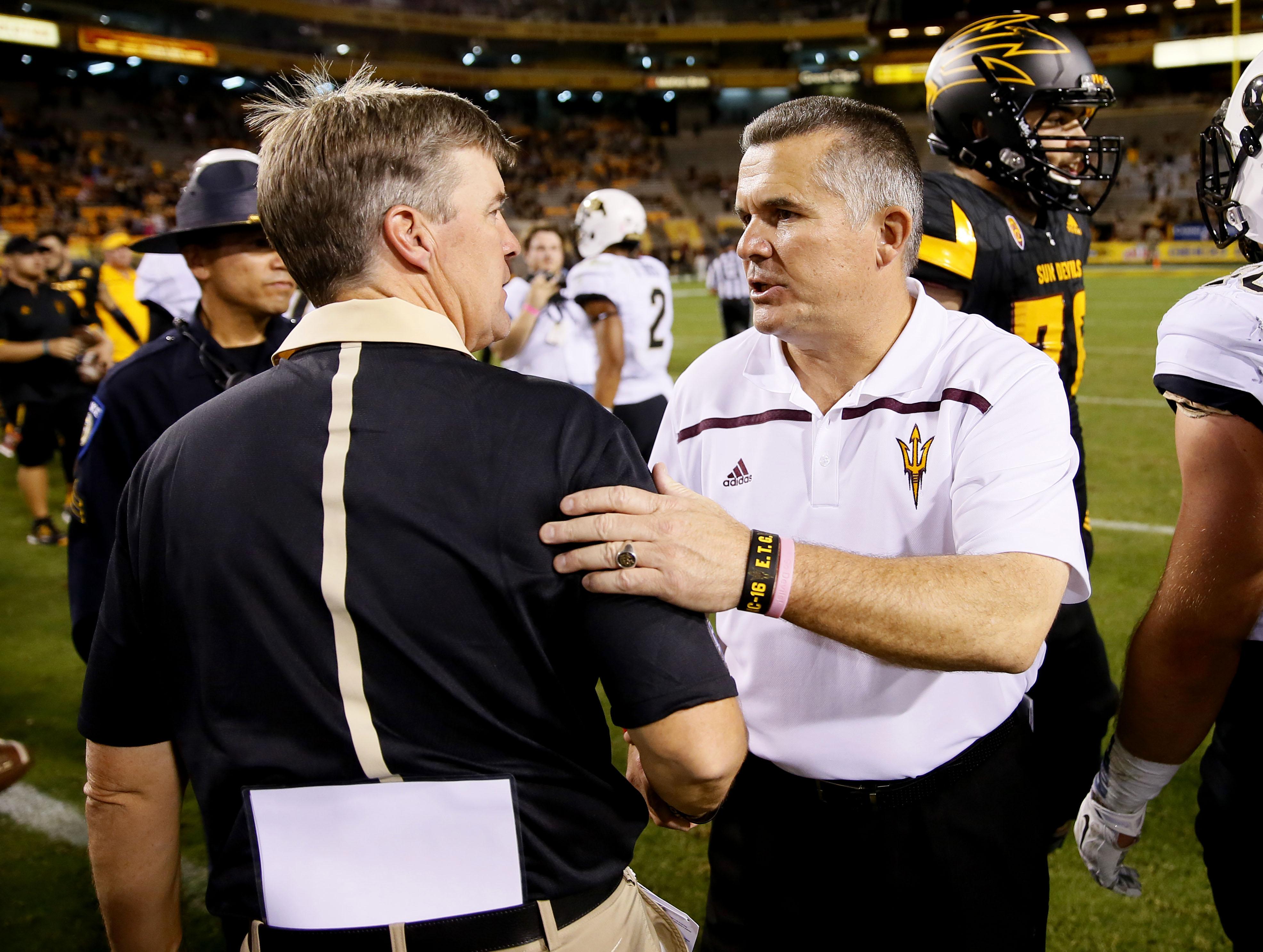 Arizona State head coach Todd Graham, right, greets Colorado head coach Mike MacIntyre after an NCAA college football game, Saturday, Oct. 10, 2015, in Tempe, Ariz. Arizona State won 48-23. (AP Photo/Matt York)