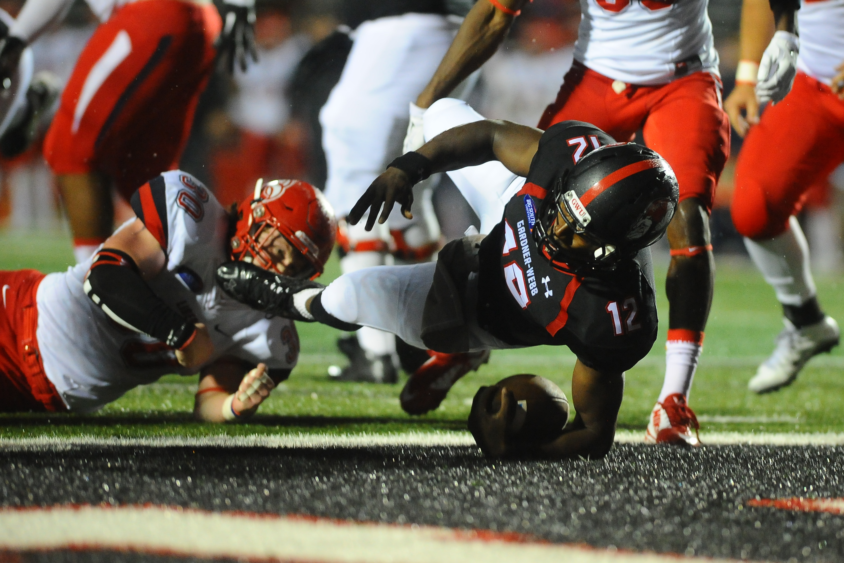 10 October 2015: Gardner-Webb upsets Liberty 34-20 for the first time since 2006 in Big South Conference football action Saturday evening at Paul Porter Arena in Boiling Springs, North Carolina.  Credit - Tim Cowie - GWUPhotos.com