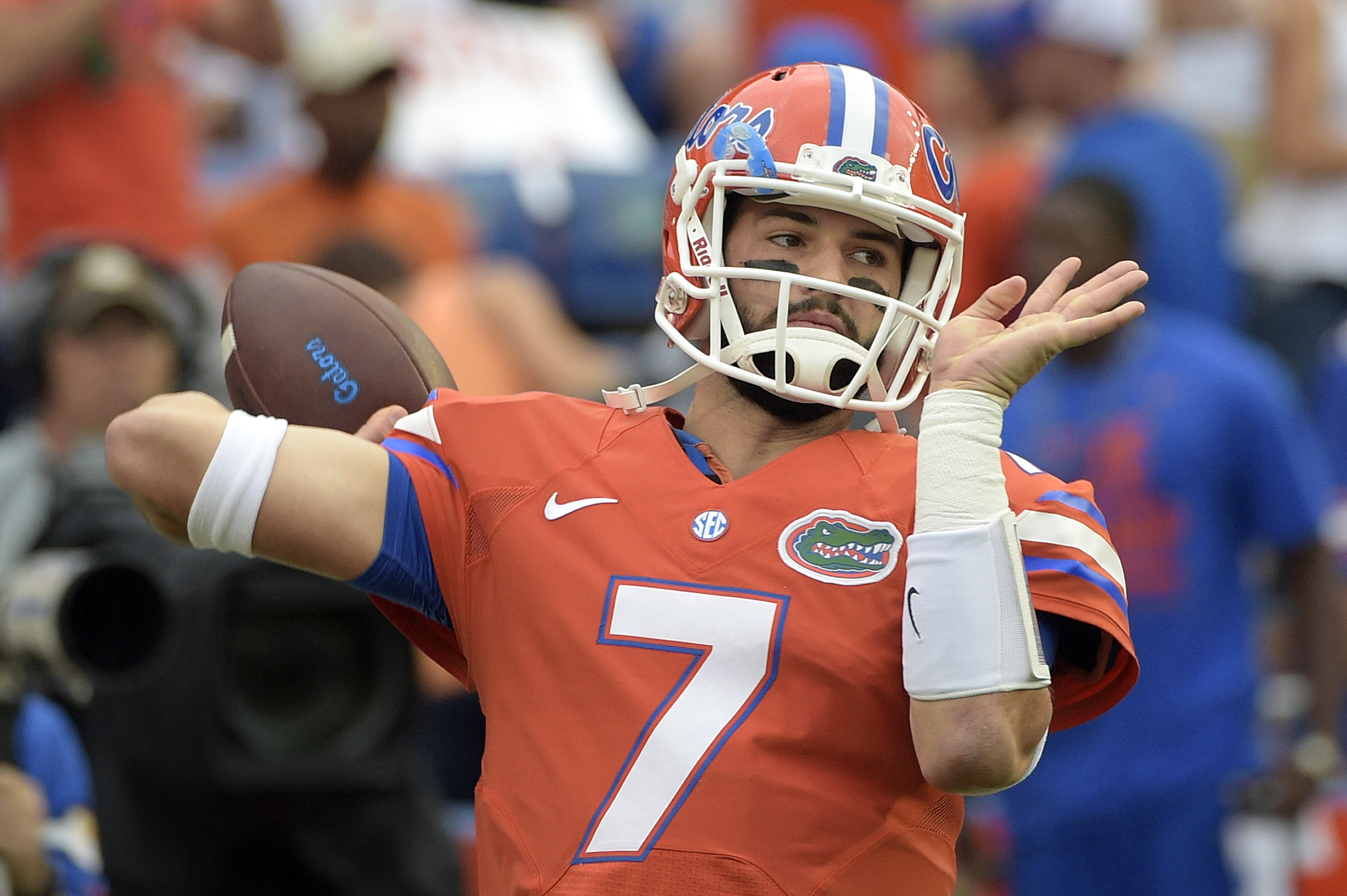 FILE - In this Oct. 3, 2015, file photo, Florida quarterback Will Grier warms up before an NCAA college football game against Mississippi in Gainesville, Fla. A person familiar with the situation says Grier has been suspended indefinitely for violating th
