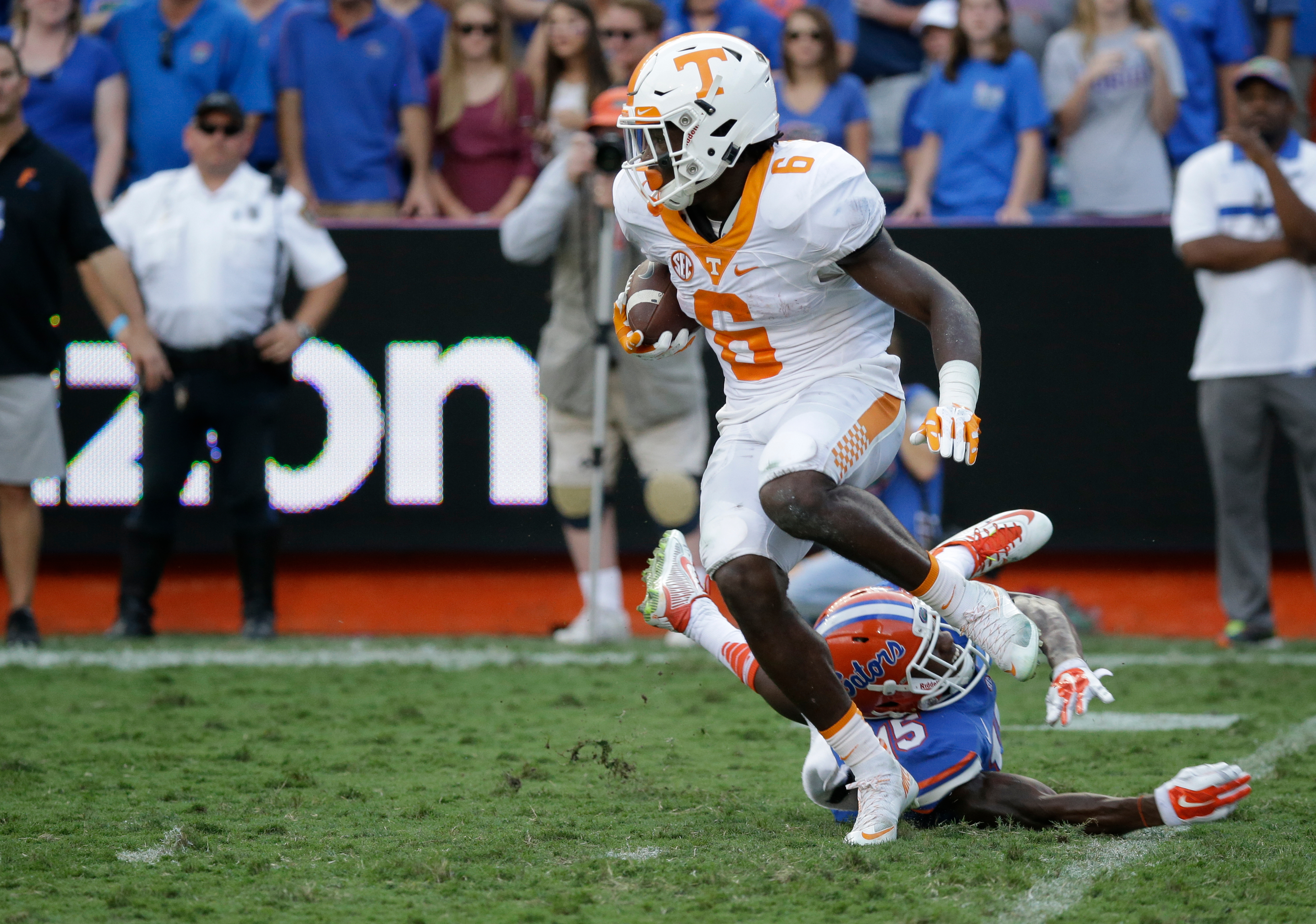 Tennessee running back Alvin Kamara (6) slips past Florida defensive back Deiondre Porter (15) during the second half of an NCAA college football game, Saturday, Sept. 26, 2015, in Gainesville, Fla. (AP Photo/John Raoux)