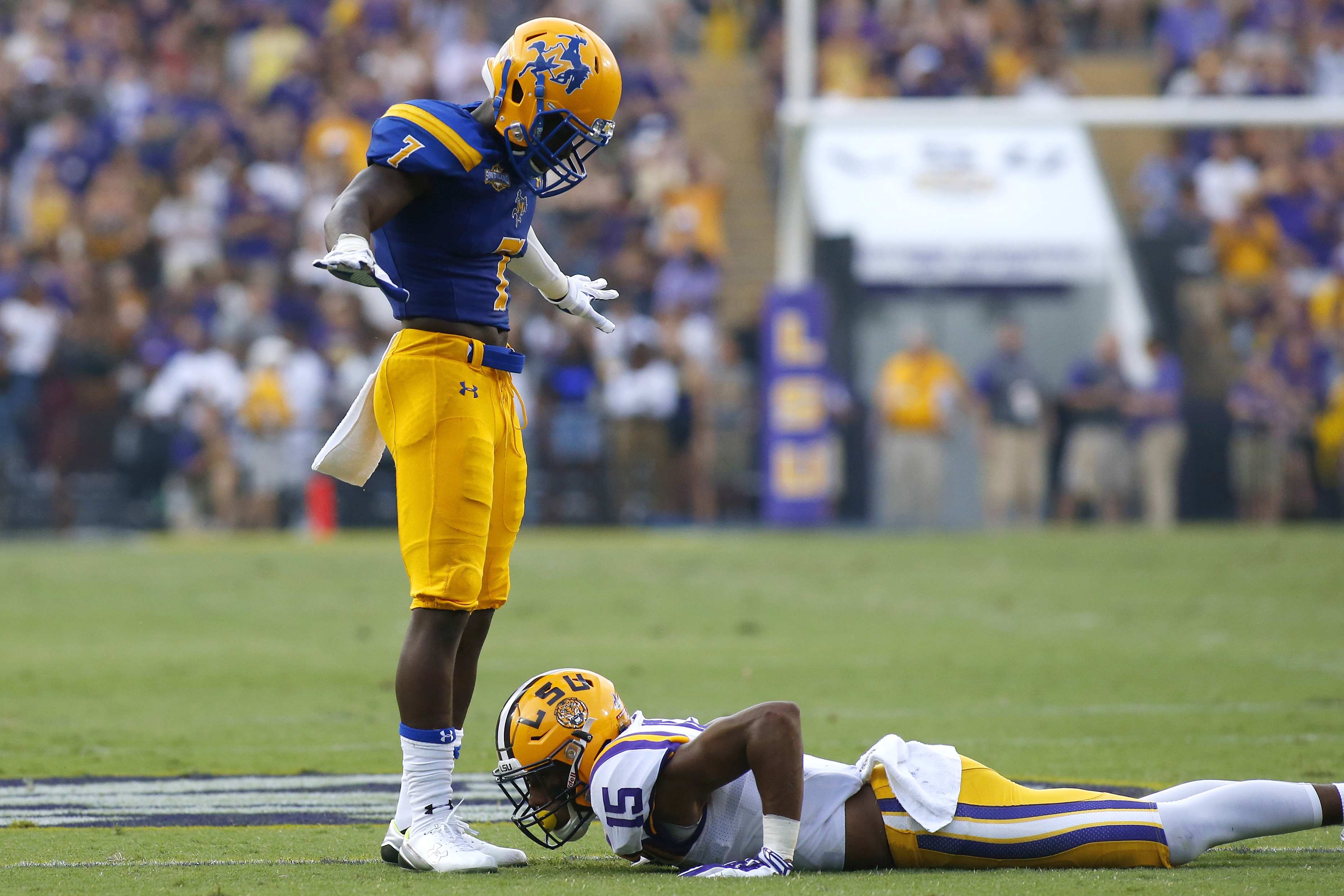 McNeese State defensive back Dominique Hill (7) stands over LSU wide receiver Malachi Dupre (15) after breaking up a pass during the first half of an NCAA college football game in Baton Rouge, La., Saturday, Sept. 5, 2015. (AP Photo/Jonathan Bachman)