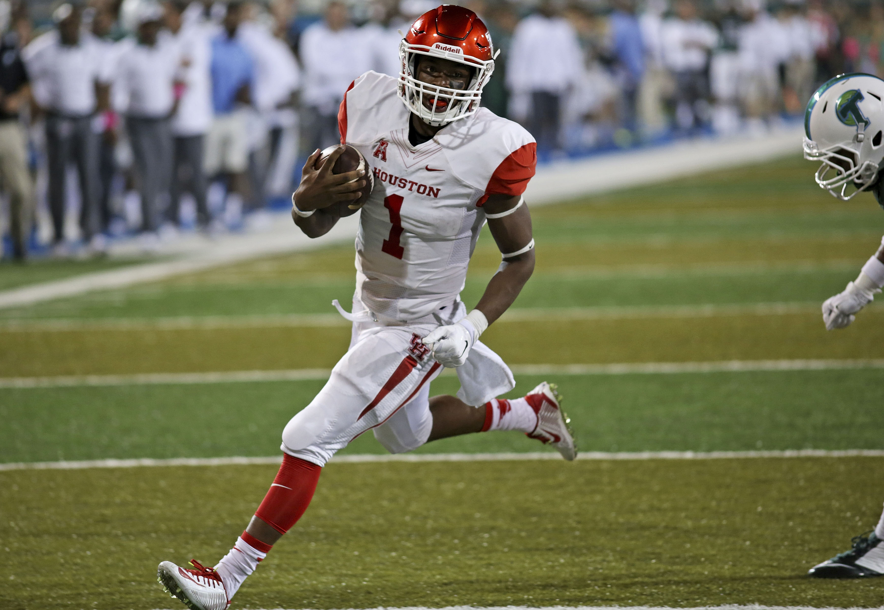 Houston quarterback Greg Ward Jr. (1) runs into the end zone to score against Tulane during an NCAA college football game in New Orleans, Friday, Oct. 16, 2015. (AP Photo/Max Becherer)