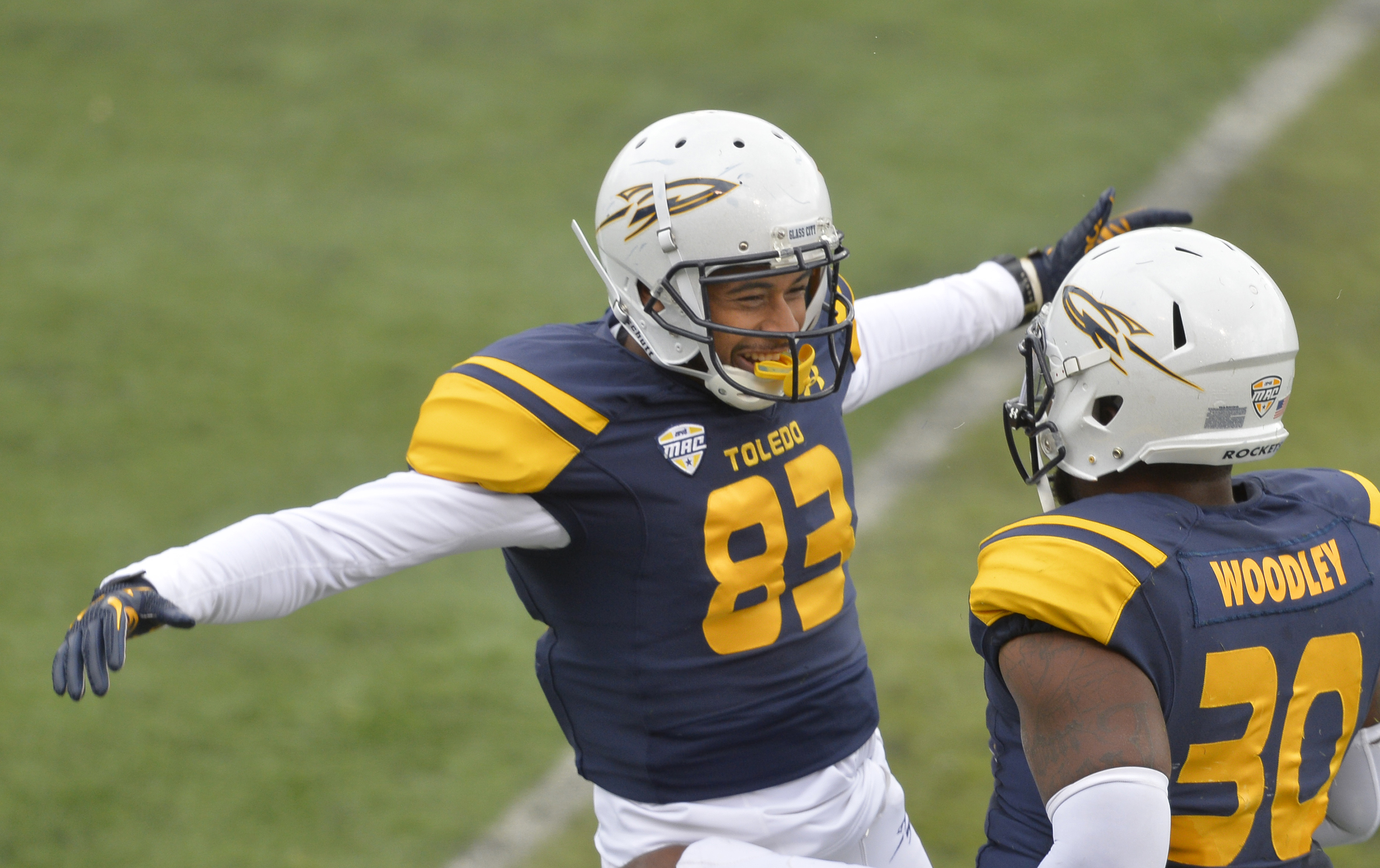 Toledo wide receiver Zach Yousey (83) celebrates his 14-yard touchdown catch with linebacker Ja'Wuan Woodley in the third quarter of an NCAA college football game against Eastern Michigan, Saturday, Oct. 17, 2015, in Toledo, Ohio. (AP Photo/David Richard)