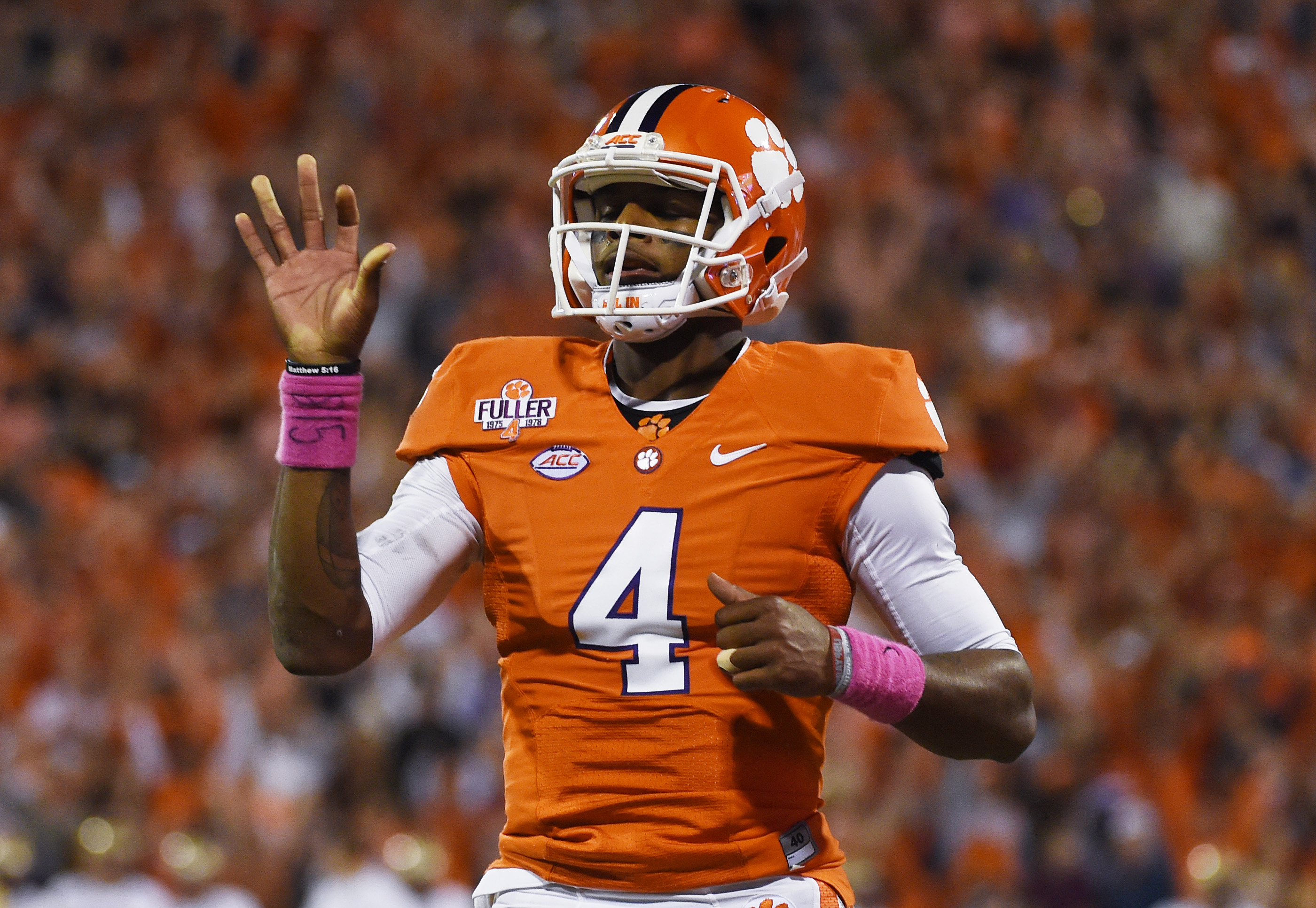 Clemson quarterback Deshaun Watson (4) waves to fans after scoring a touchdown against Boston College during the first half of an NCAA college football game, Saturday, Oct. 17, 2015, in Clemson, S.C. (AP Photo/Rainier Ehrhardt)