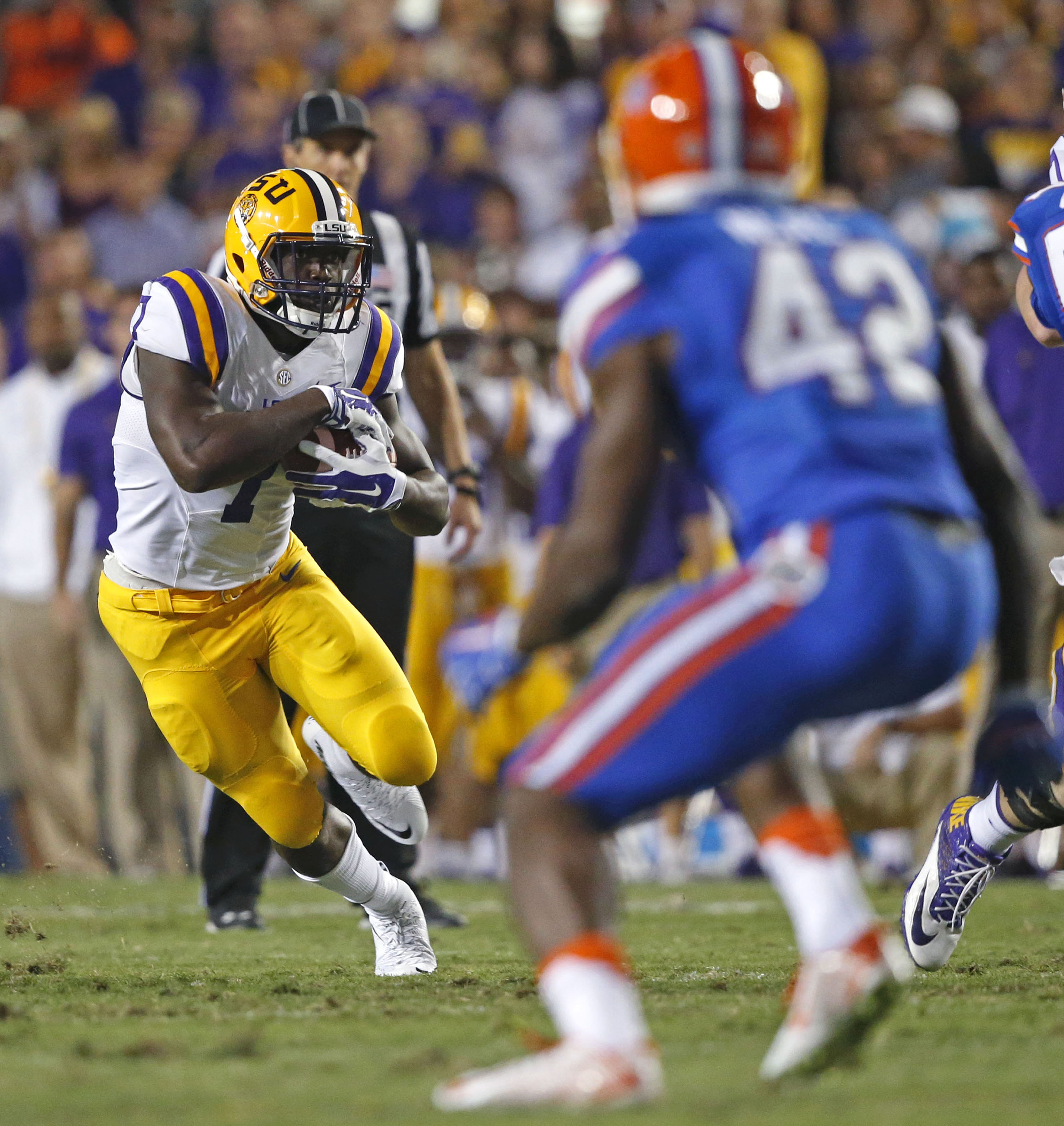 LSU running back Leonard Fournette (7) carries in the first half of an NCAA college football game against Florida in Baton Rouge, La., Saturday, Oct. 17, 2015. (AP Photo/Gerald Herbert)