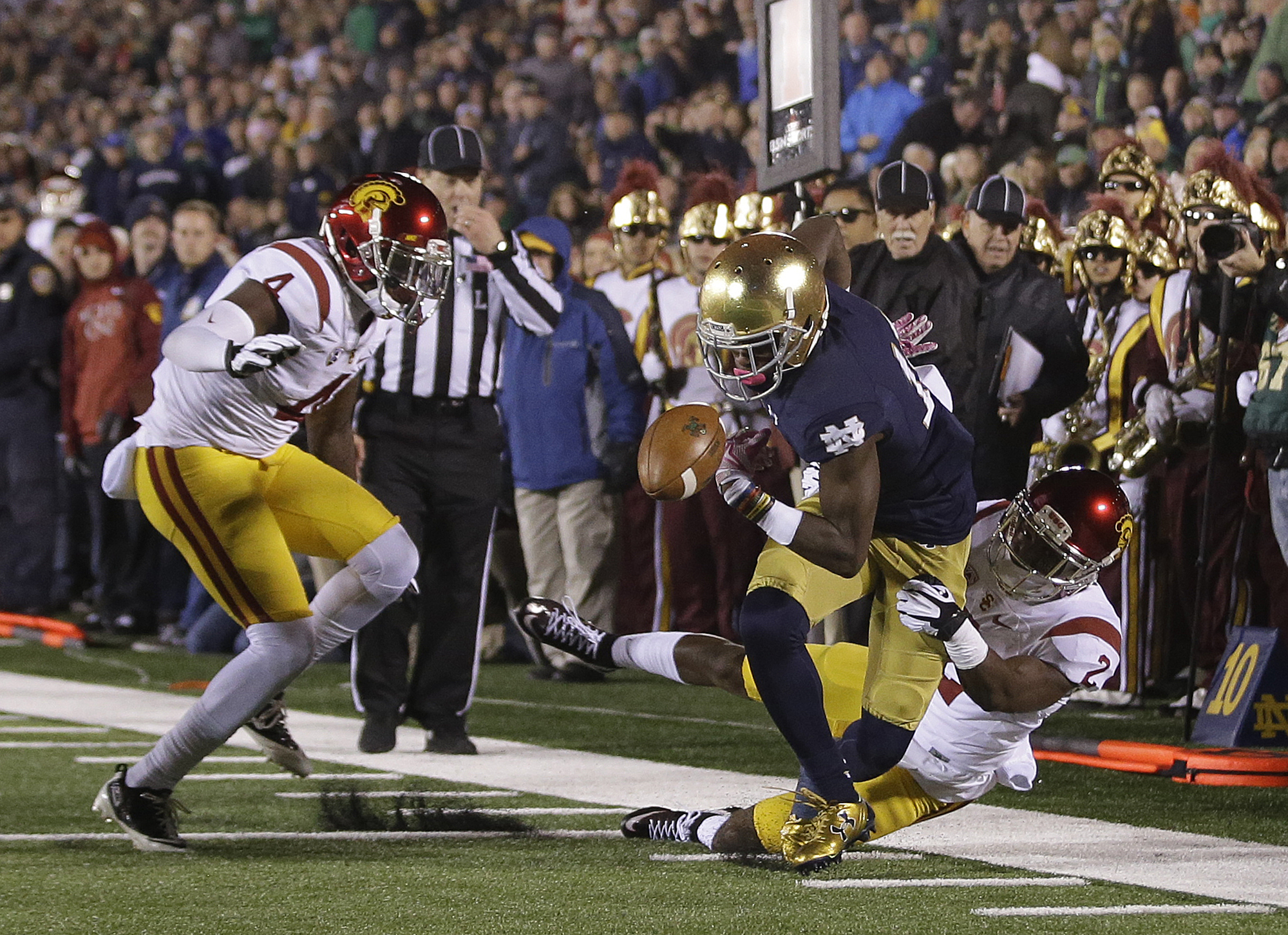 Notre Dame's Torii Hunter Jr. (16) fumbles as he is tackled by Southern California's Adoree' Jackson (2) during the first half of an NCAA college football game Saturday, Oct. 17, 2015, in South Bend, Ind.  Chris Hawkins (4) is at left. (AP Photo/Darron Cu
