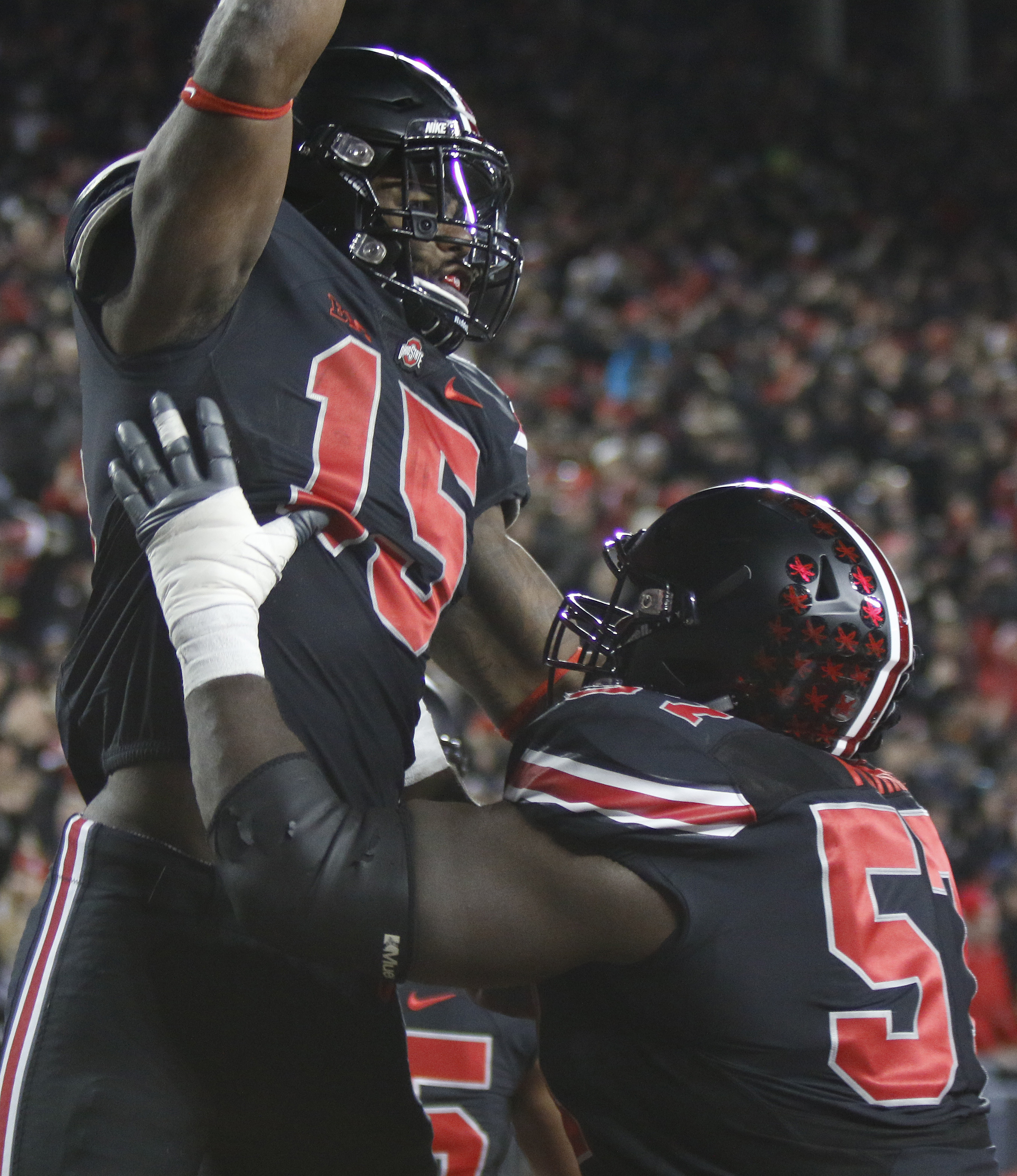 Ohio State running back Ezekiel Elliott, left, celebrates his touchdown against Penn State with teammate offensive lineman Chase Farris during the first half of an NCAA college football game Saturday, Oct. 17, 2015, in Columbus, Ohio. (AP Photo/Paul Verno