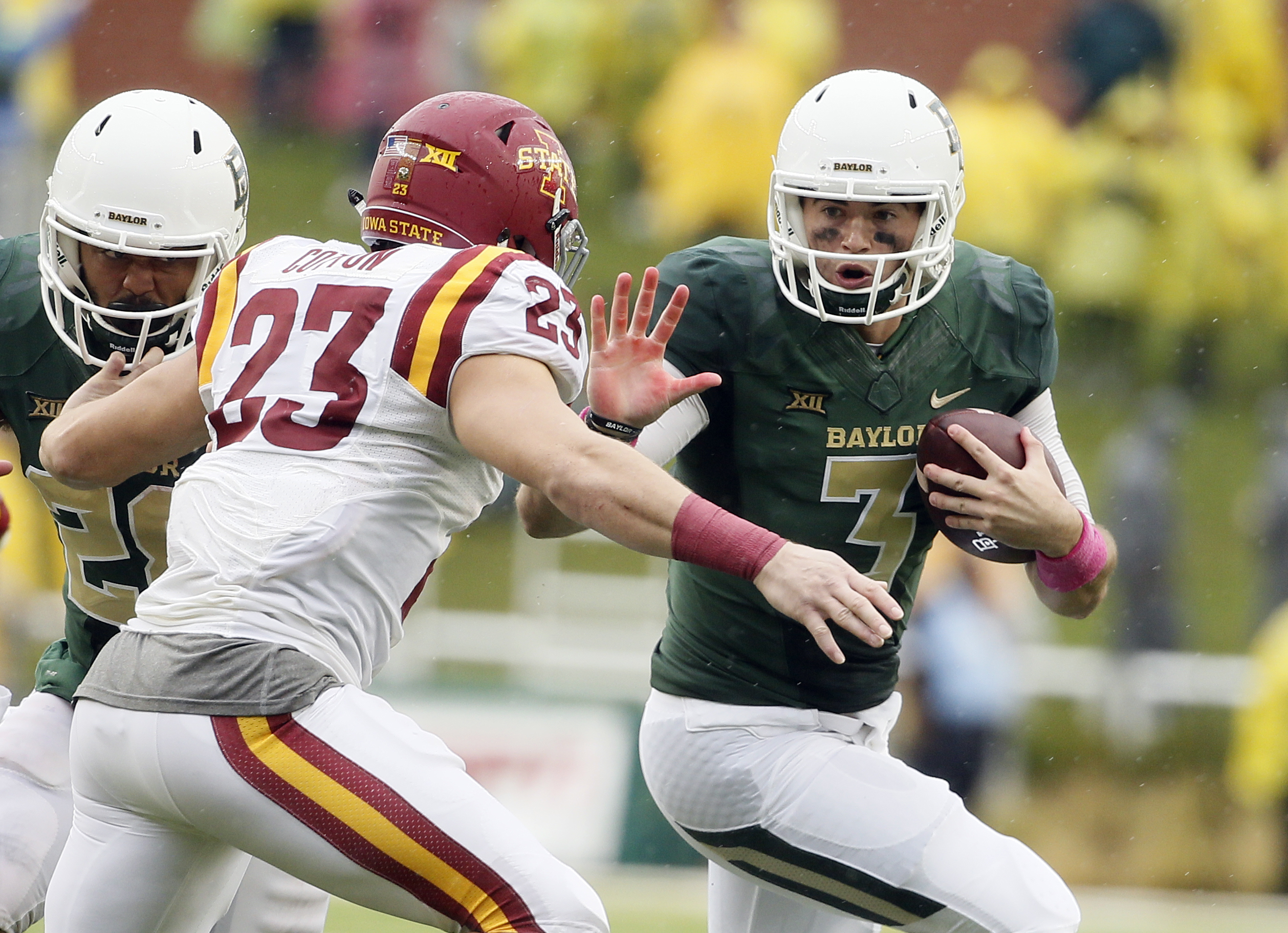 Iowa State defensive back Darian Cotton (23) chases down Baylor quarterback Jarrett Stidham (3) on a running play in the second half of an NCAA college football game Saturday, Oct. 24, 2015, in Waco, Texas. Baylor won 45-27. (AP Photo/Tony Gutierrez)