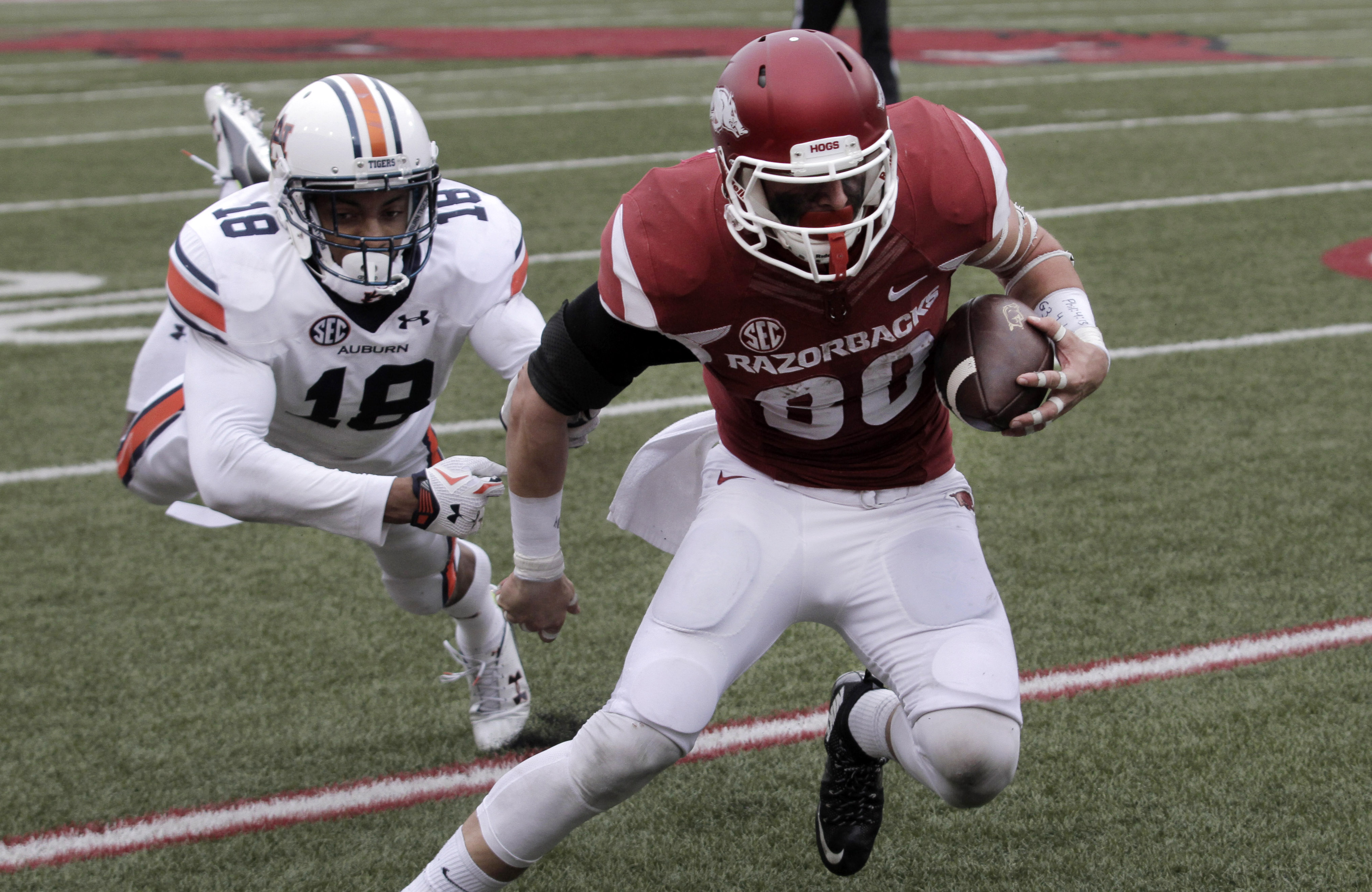 Arkansas' Drew Morgan (80) escapes an attempted tackle by Auburn's Carlton Davis (18) to score a touchdown during the fourth overtime of the NCAA college football game Saturday, Oct. 24, 2015, in Fayetteville, Ark. Arkansas won 54-46 in four overtimes. (A