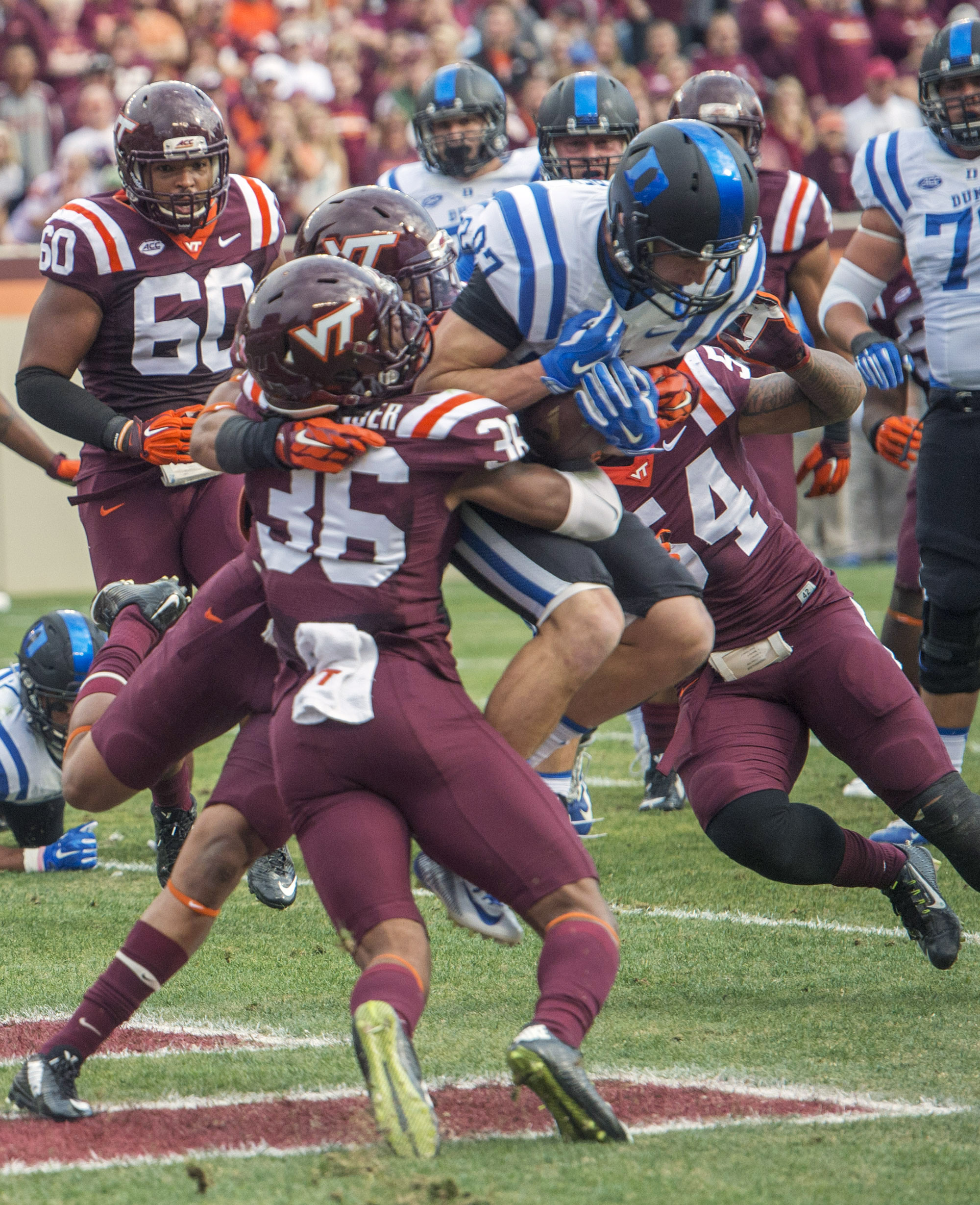 Duke's Max McCaffrey (87) makes a touchdown catch in the end zone between Virginia Tech defenders Adonis Alexander (36) and  Andrew Matuapuoka (54) during the first half an NCAA college football game against Duke's, Saturday, Oct. 24, 2015, at Lane Stadiu