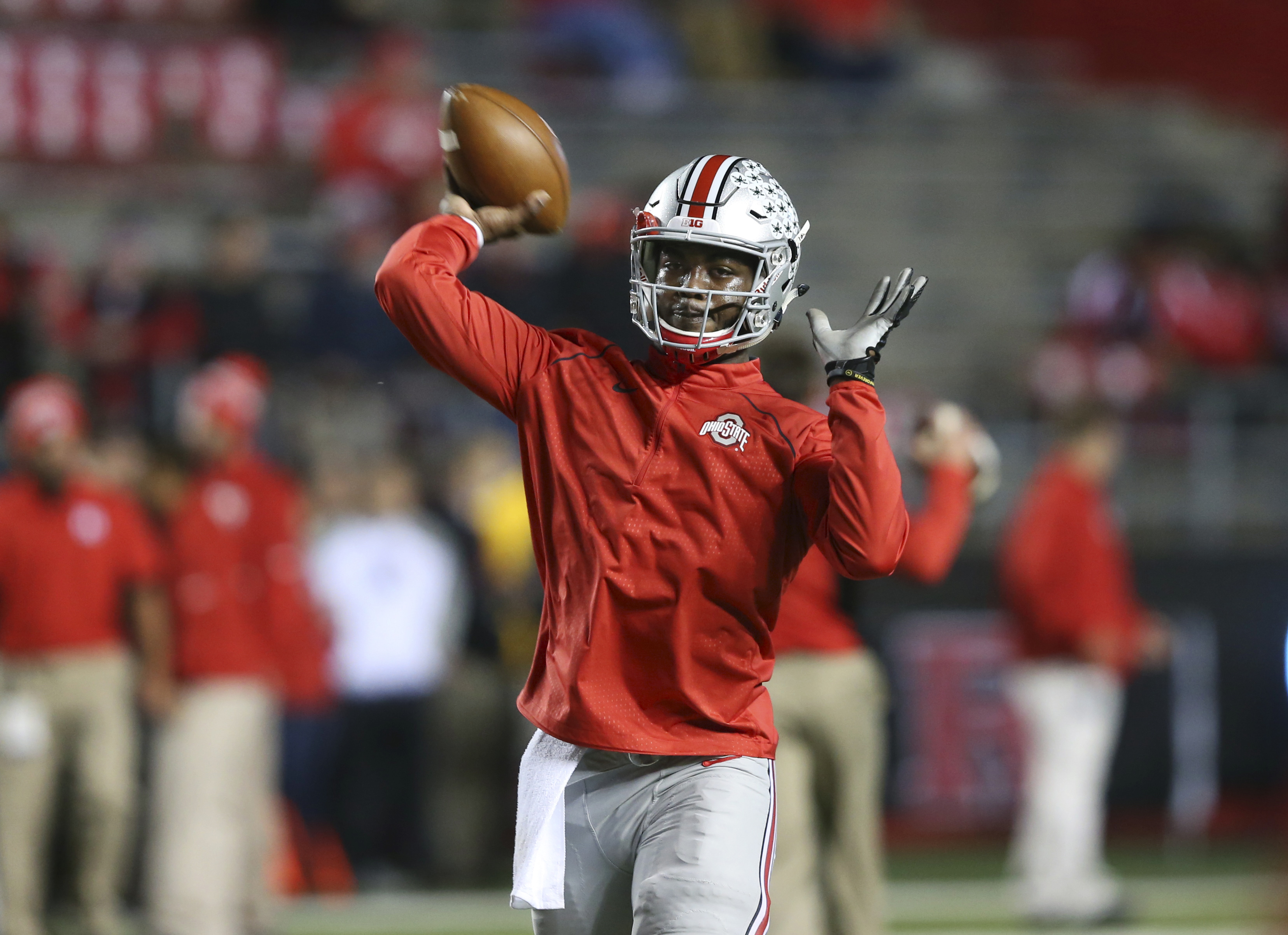 Ohio State quarterback J.T. Barrett throws a pass as the team warms up before an NCAA college football game against Rutgers Saturday, Oct. 24, 2015, in Piscataway, N.J. (AP Photo/Mel Evans)