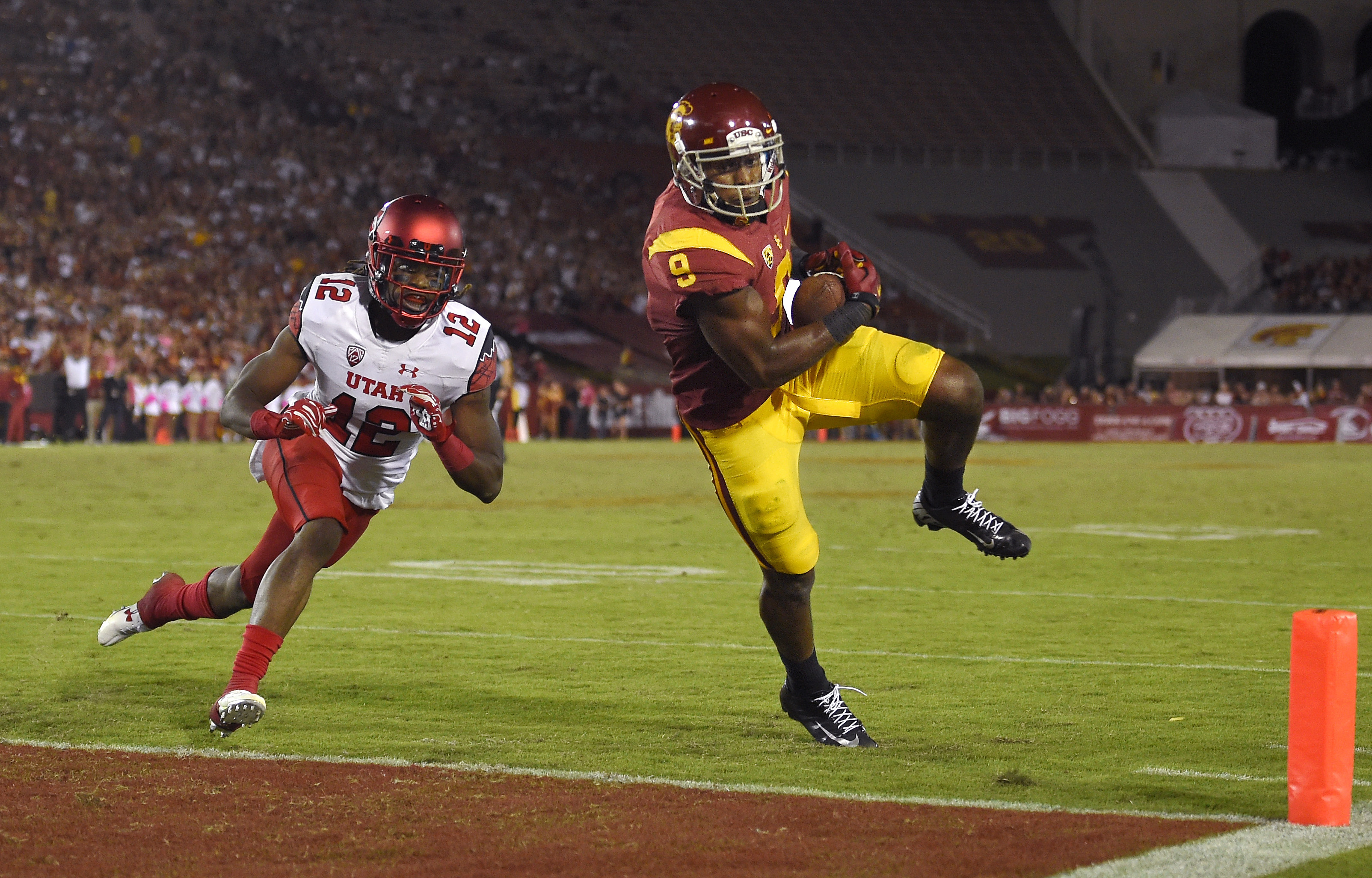 Southern California wide receiver JuJu Smith-Schuster, right, heads in for a touchdown under pressure from Utah defensive back Justin Thomas during the second half of an NCAA college football game, Saturday, Oct. 24, 2015, in Los Angeles. Southern Califor