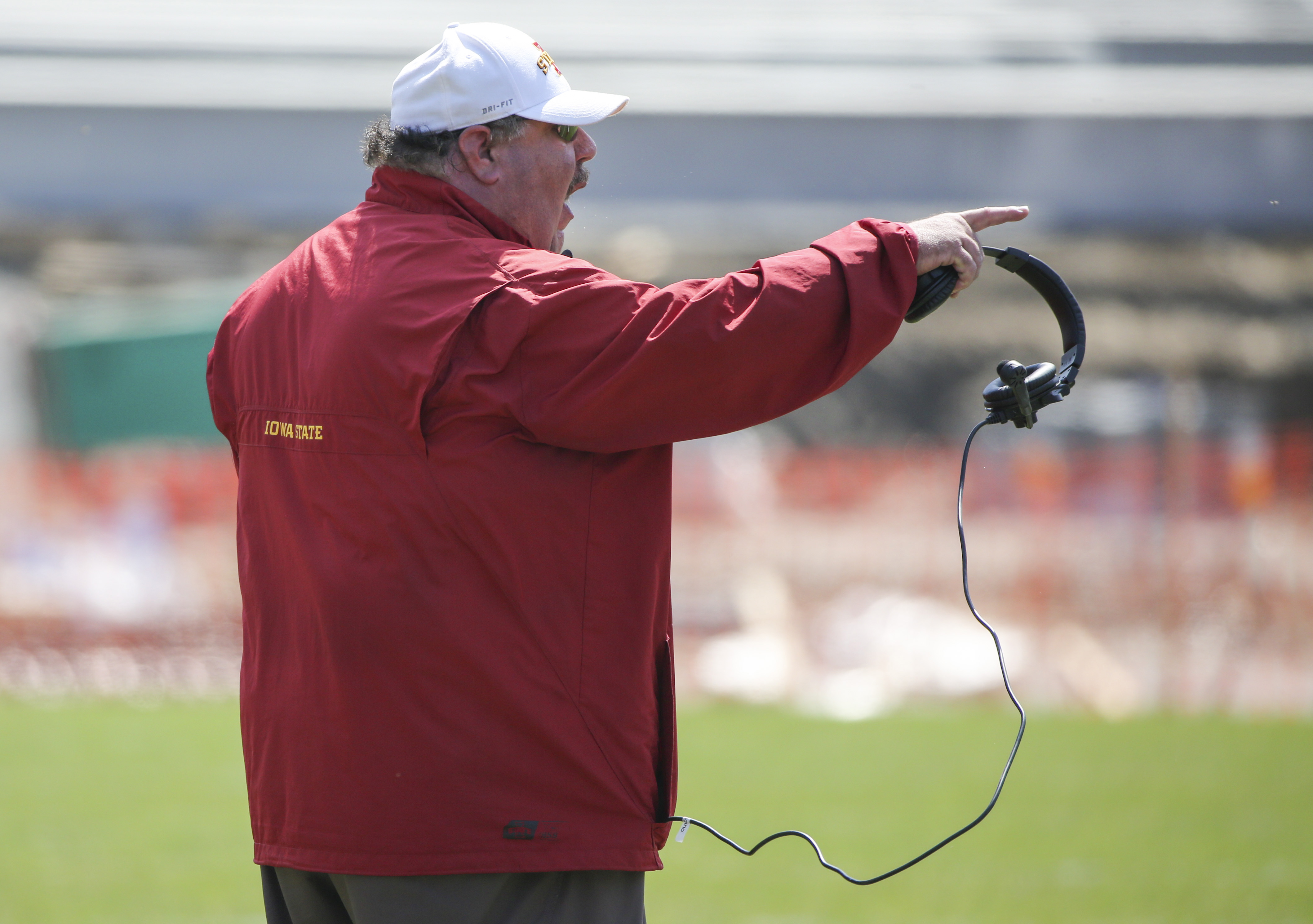 Iowa State offensive coordinator Mark Mangino yells instructions to the offense during the Iowa State spring college football game, Saturday, April 11, 2015, in Ames, Iowa. (AP Photo/Justin Hayworth)